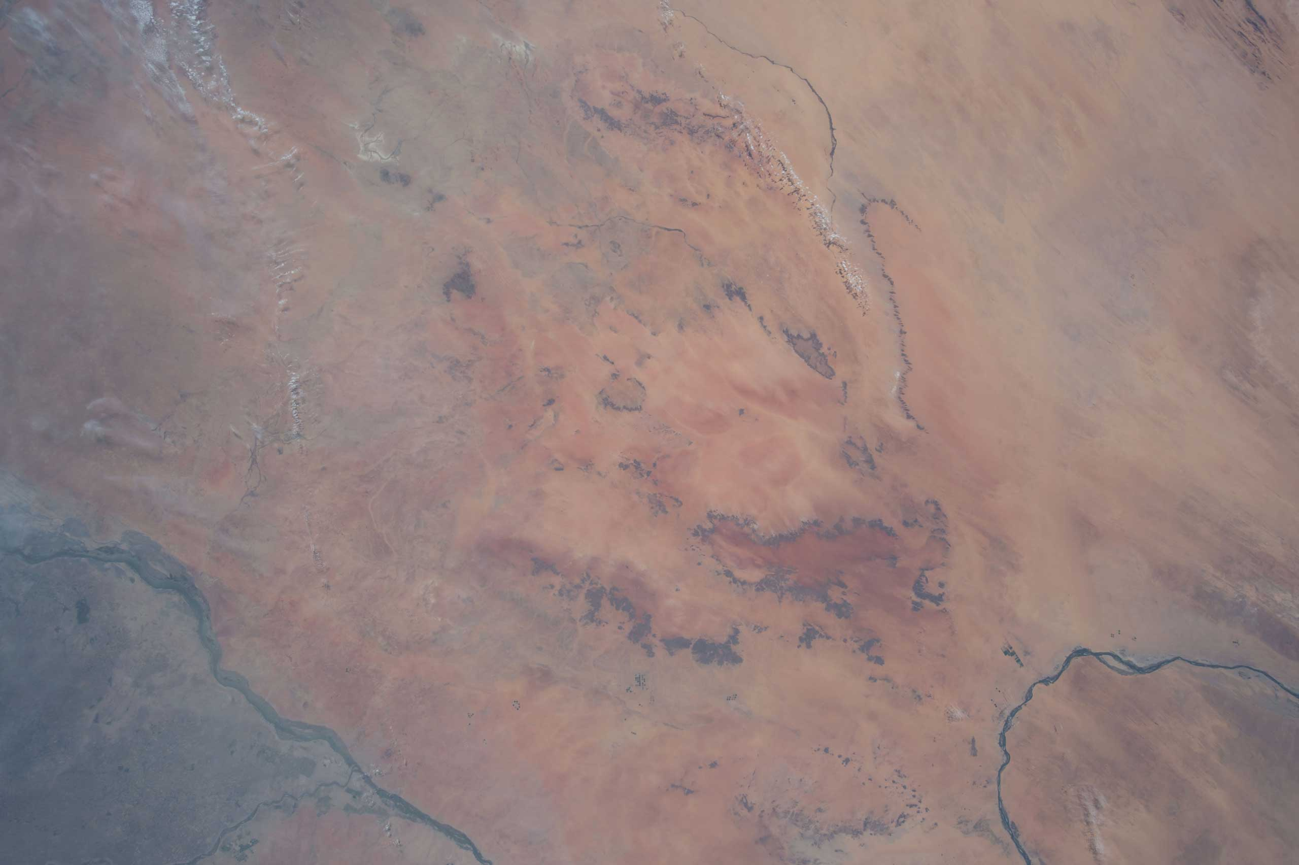 NASA astronaut Terry Virts onboard the International Space Station tweeted this deep beige and red desert image in Africa on Apr. 16, 2015. Terry's comments that accompanied the image were:  Beautiful colors in the northern desert of #Africa .