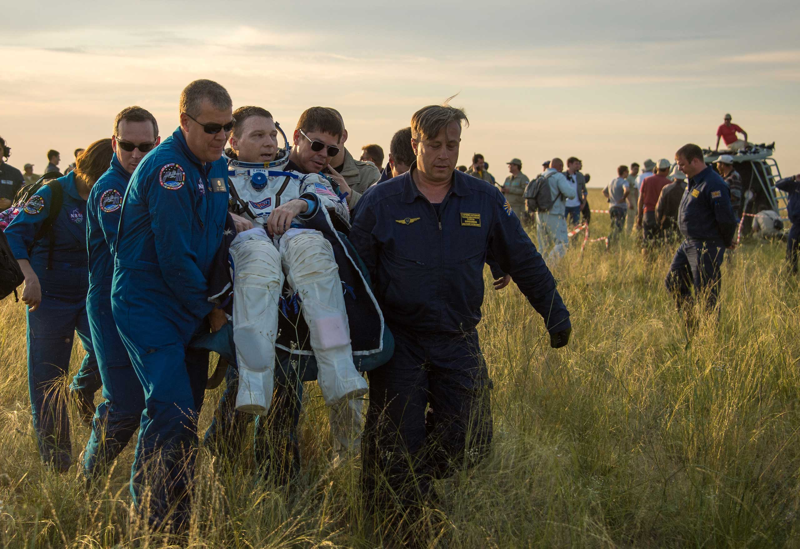 Shortly after his return from space, Virts is carried into a medical tent near the town of Zhezkazgan, Kazakhstan on June 11, 2015.