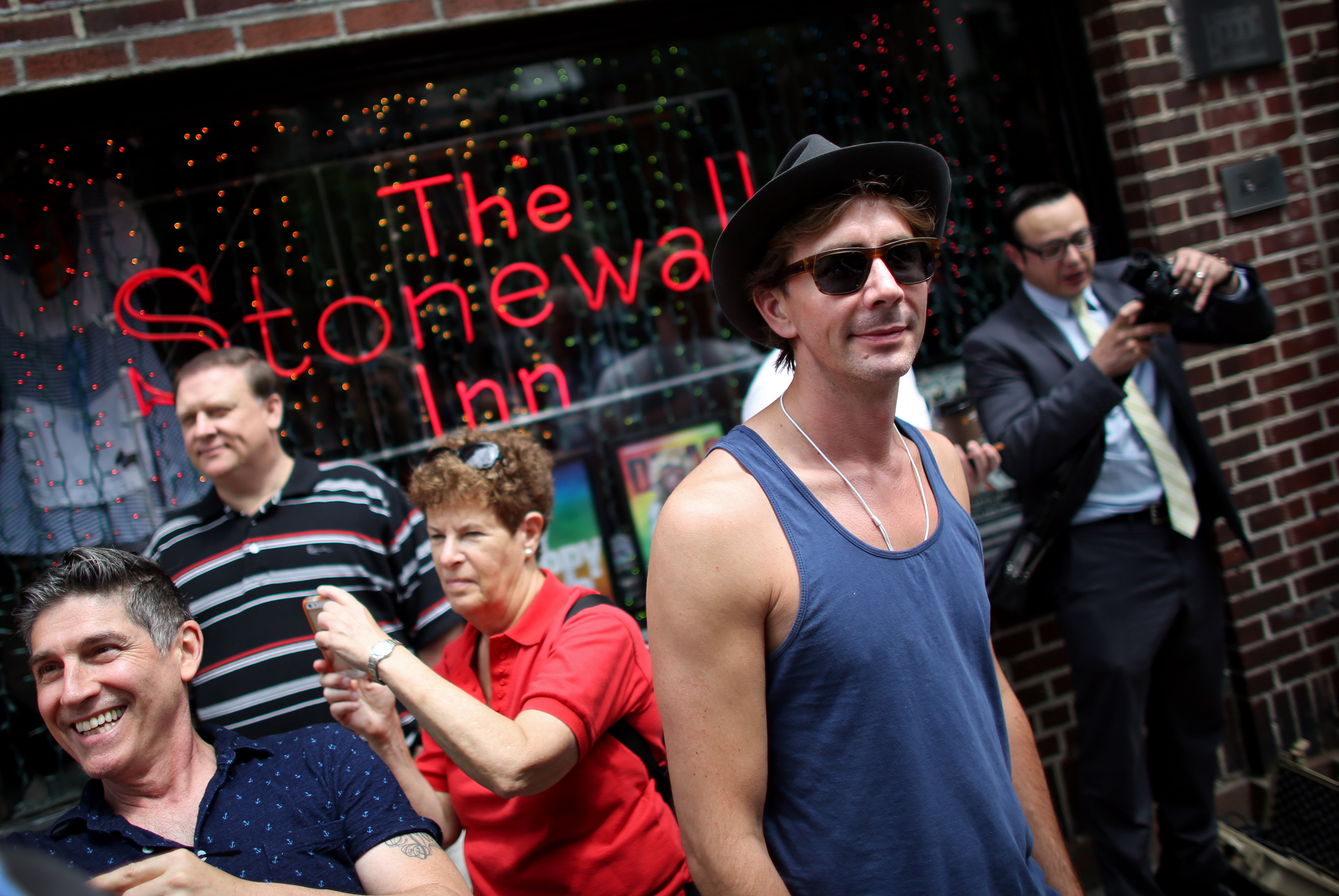 People gather outside of the Stonewall Inn, an iconic gay bar recently granted historic landmark status, on June 26, 2015 in the West Village neighborhood in New York City.