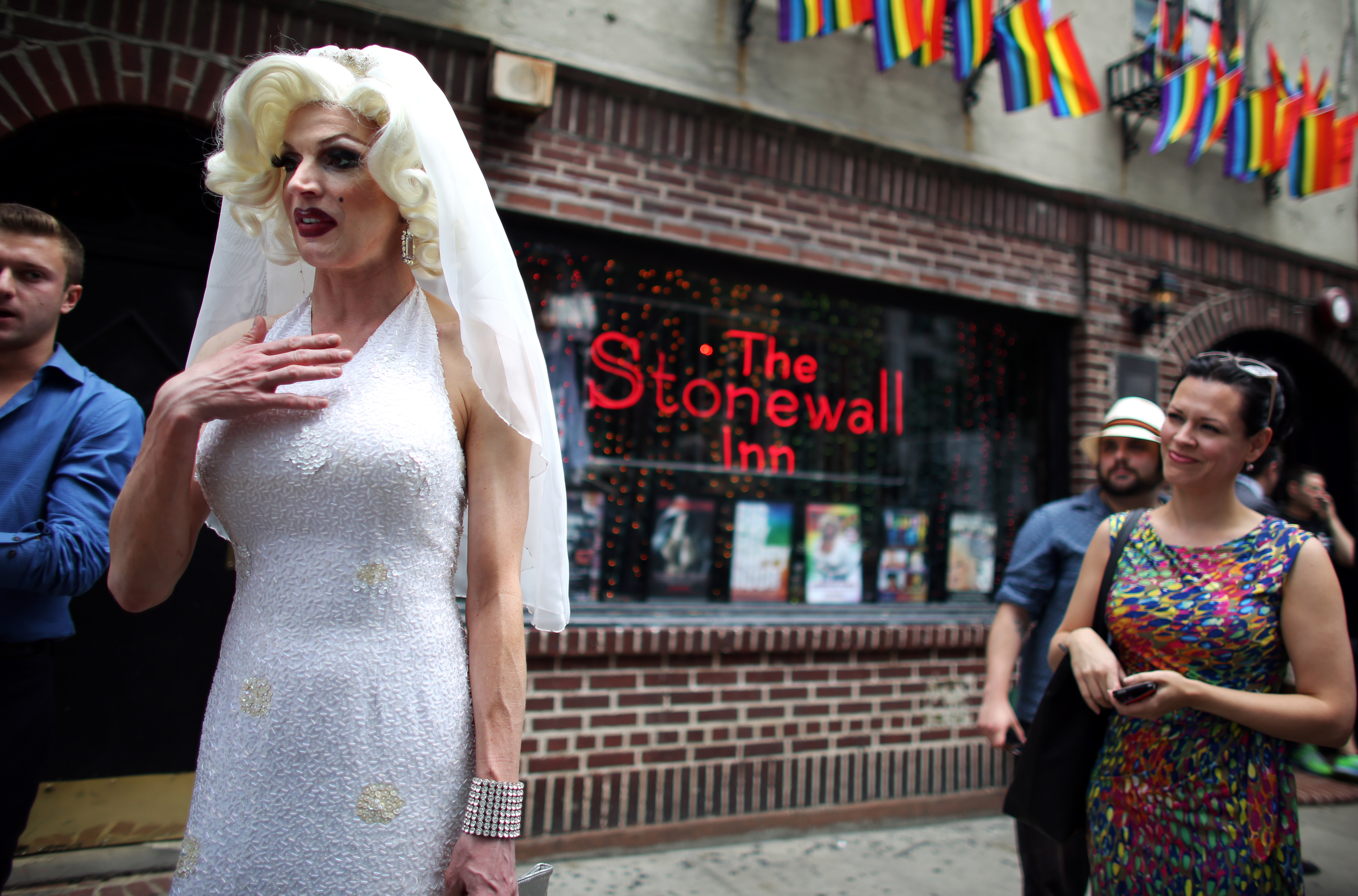 Carlotta Gurl, a gay rights activist from Vancouver, Canada, chats outside of the Stonewall Inn, an iconic gay bar recently granted historic landmark status, on June 26, 2015 in the West Village neighborhood in New York City.