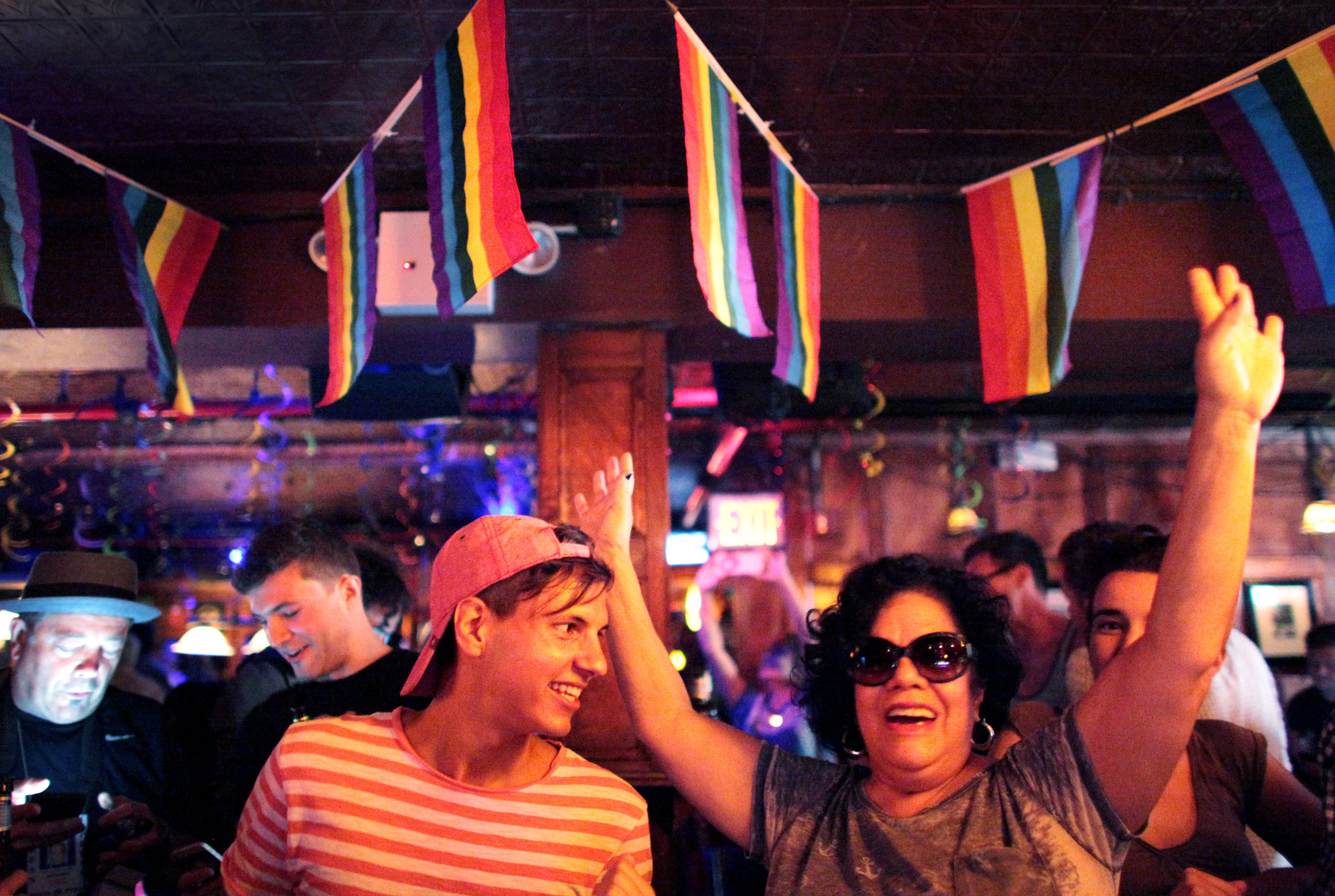 People celebrate inside the Stonewall Inn, an iconic gay bar recently granted historic landmark status, on June 26, 2015 in the West Village neighborhood in New York City.
