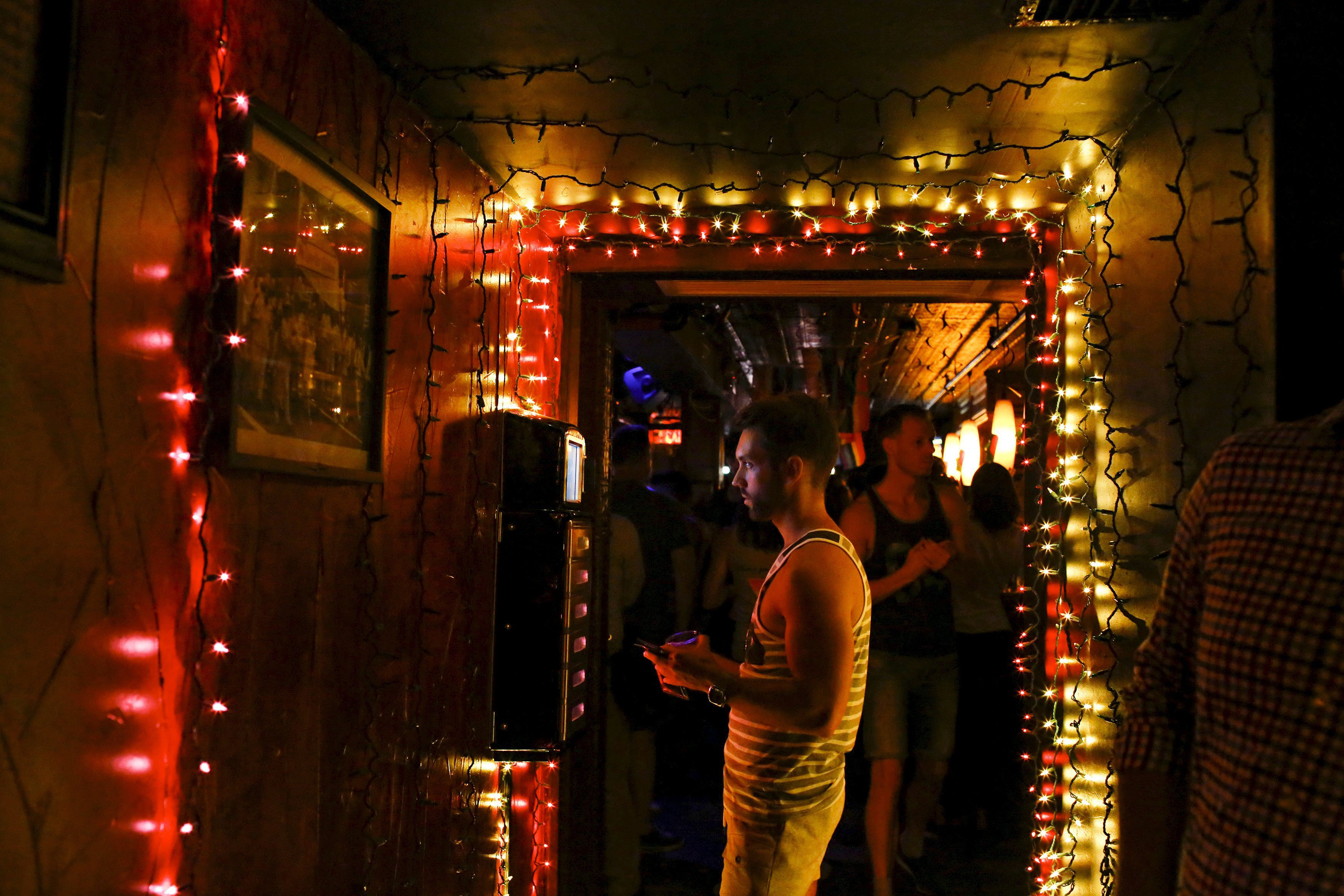 A man plays music as people celebrate inside the Stonewall Inn in the West Village neighborhood of New York, June 26, 2015.