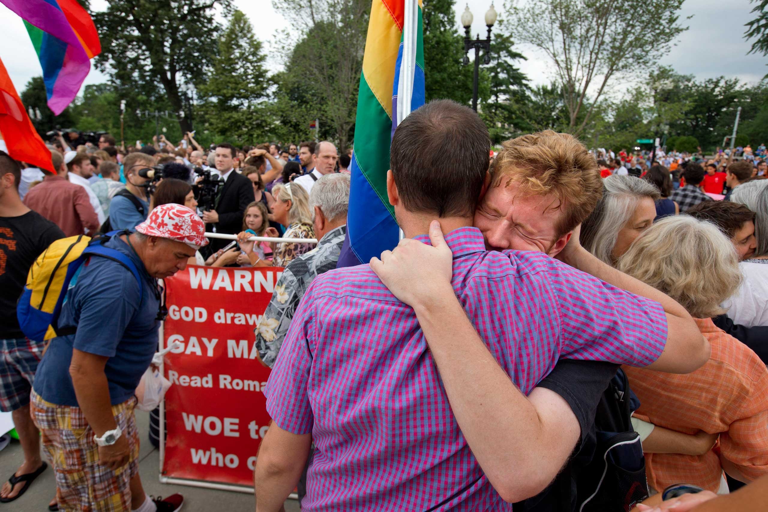 John Becker, right, hugs his friend and fellow LGBT advocate Paul Guequierre, outside the Supreme Court in Washington on June 26, 2015.