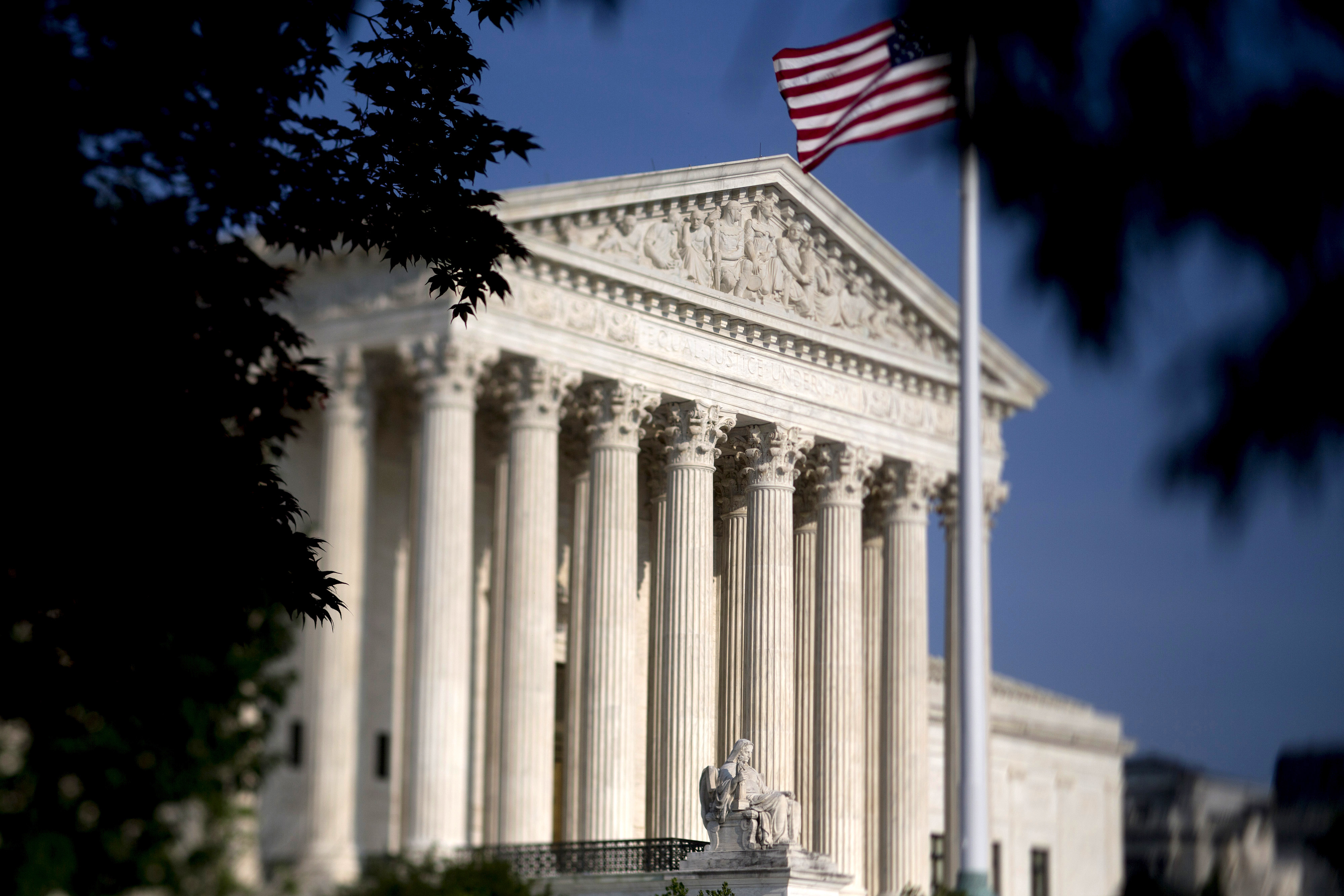 The American flag flies next to the U.S. Supreme Court.