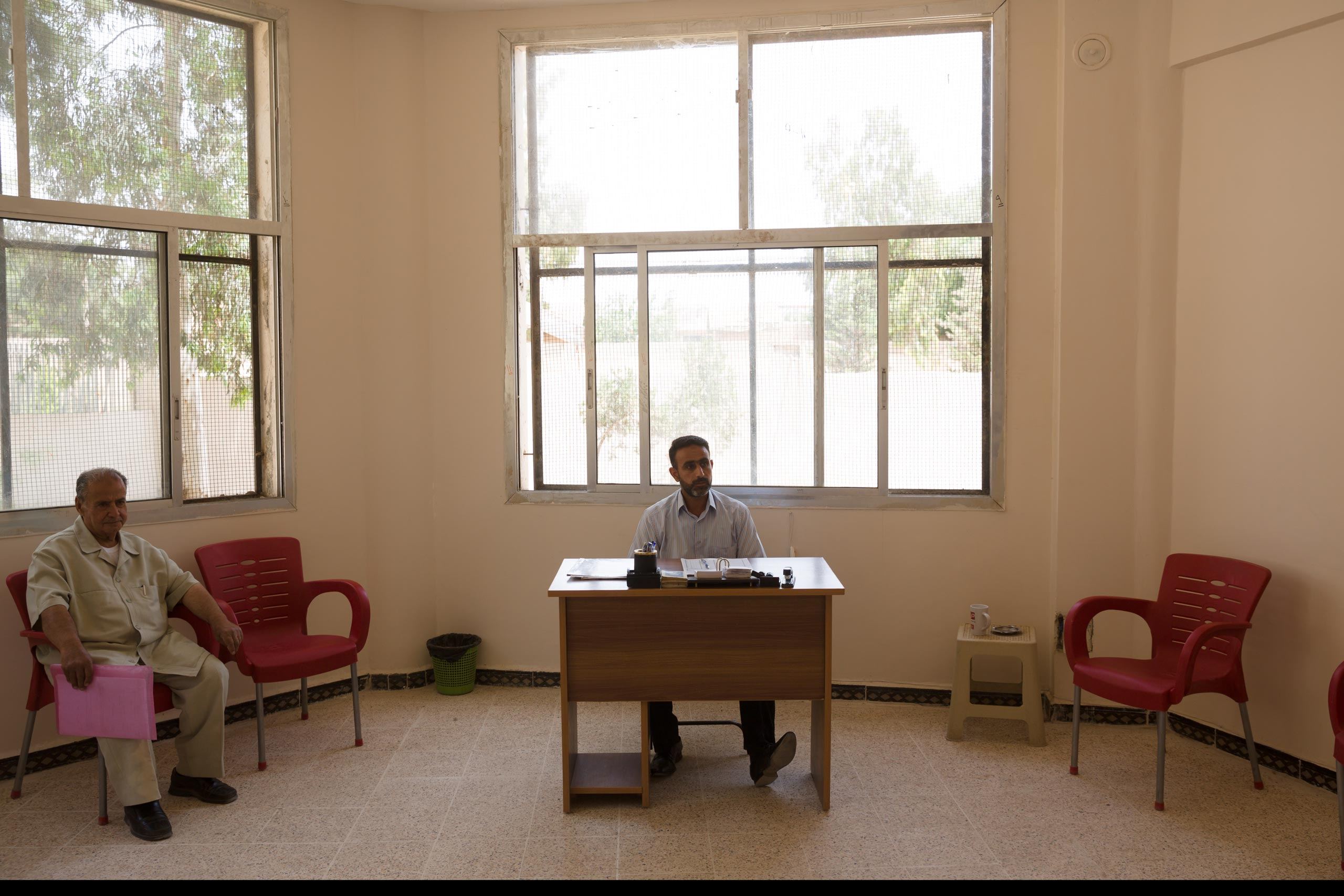 A judge in in a temporary office of Deir-ez Zor's  state-run court handles mainly administrative matters like birth and wedding certificates. In areas in Syria and Iraq where ISIS is in control, Sharia law prevails, May 25, 2015.