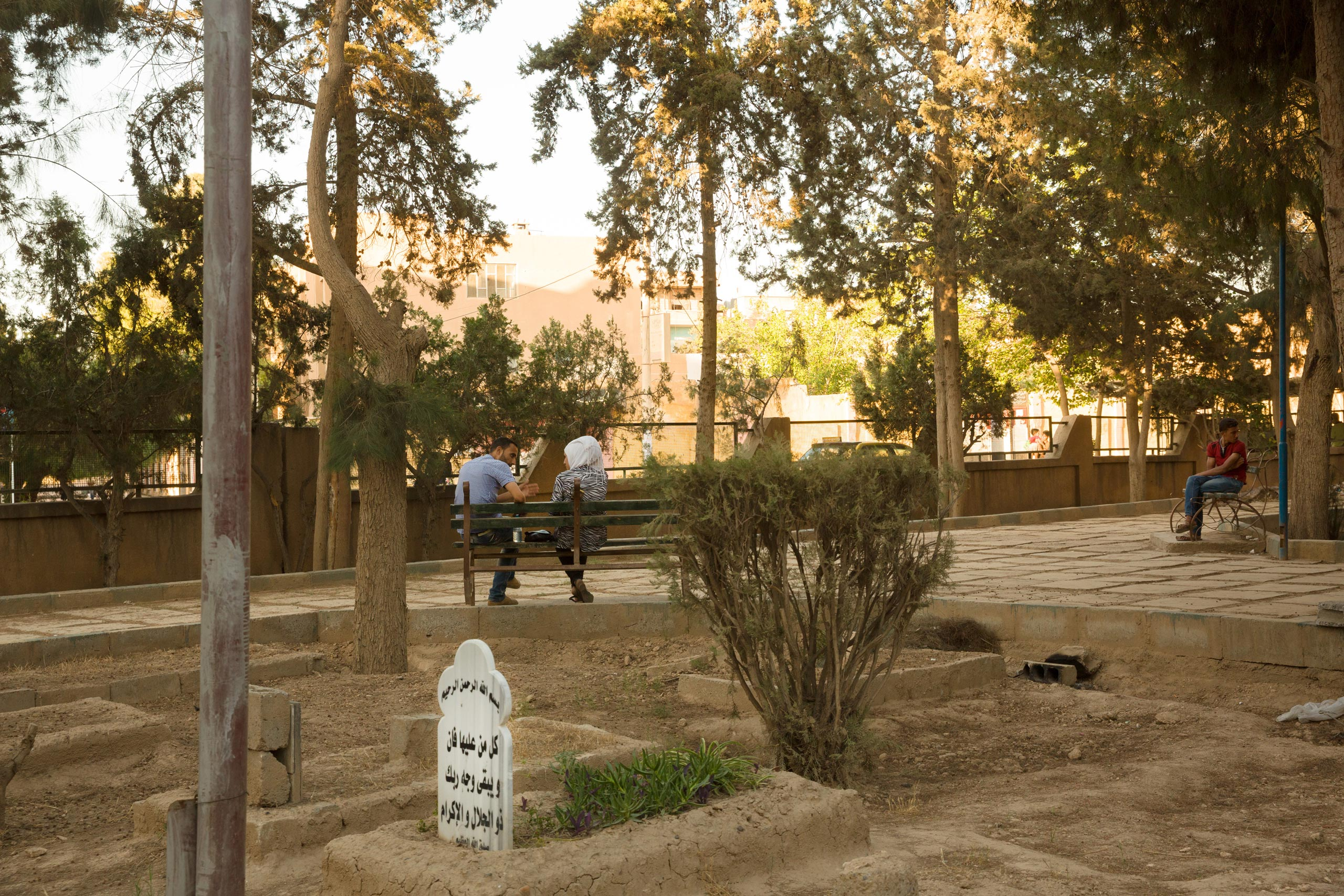 A burial ground in a city park in Deir-ez Zor. Residents have stopped burying their dead in the main cemetery where they fear being targeted by ISIS snipers who surround the city, June 1, 2015.