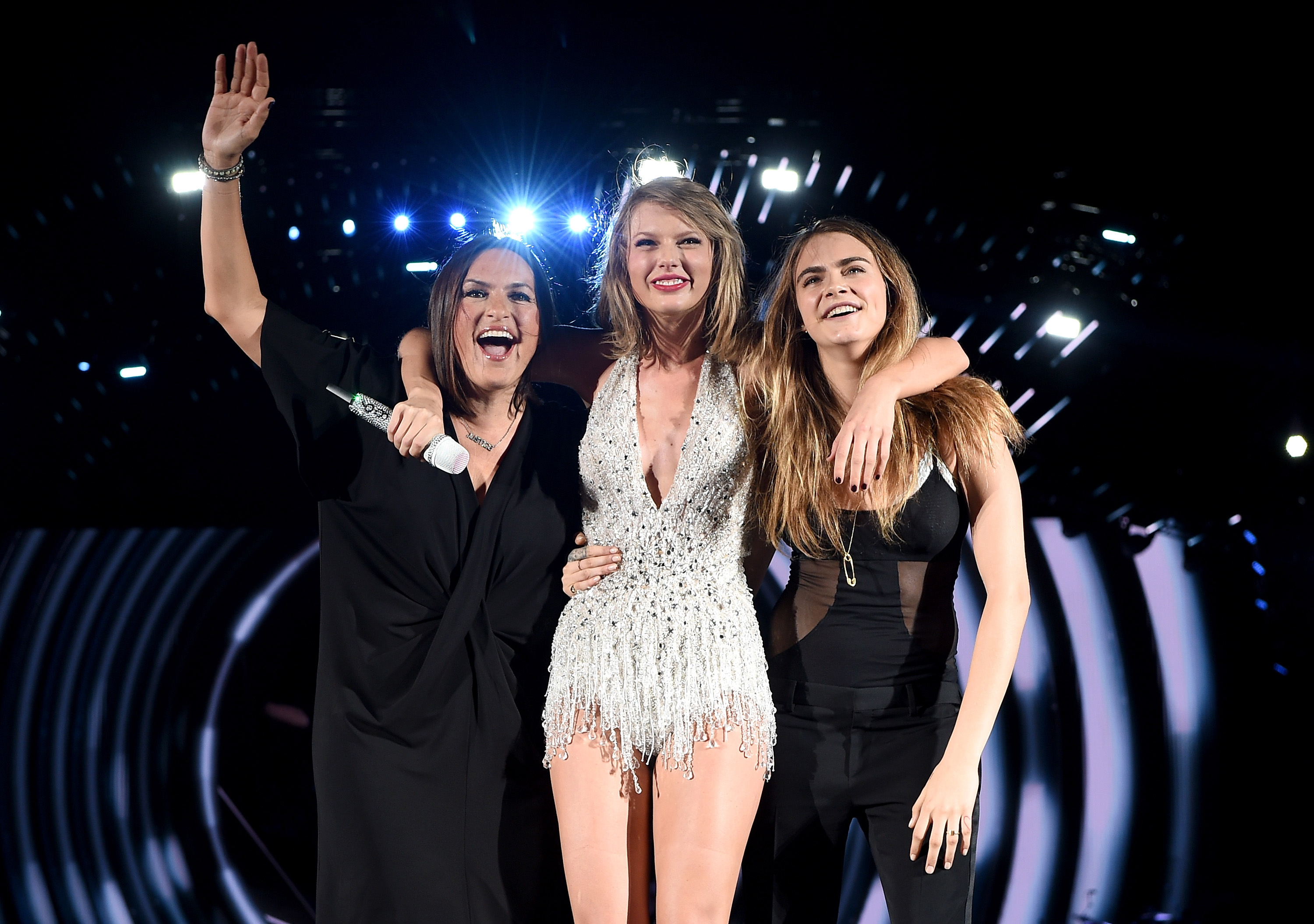 (L-R) Mariska Hargitay, Taylor Swift, and Cara Delevingne pose onstage during The 1989 World Tour on June 12, 2015 at Lincoln Financial Field in Philadelphia.
