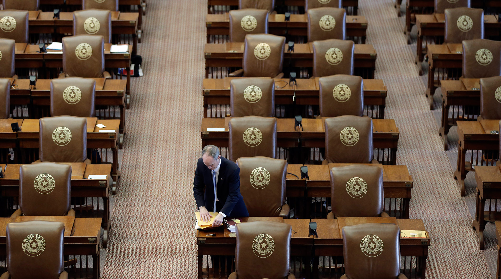 Rep. Mike Schoefield packs up his desk after the House adjourned on the final day of the legislative session in the House Chamber at the Texas Capitol on June 1, 2015, in Austin, TX.