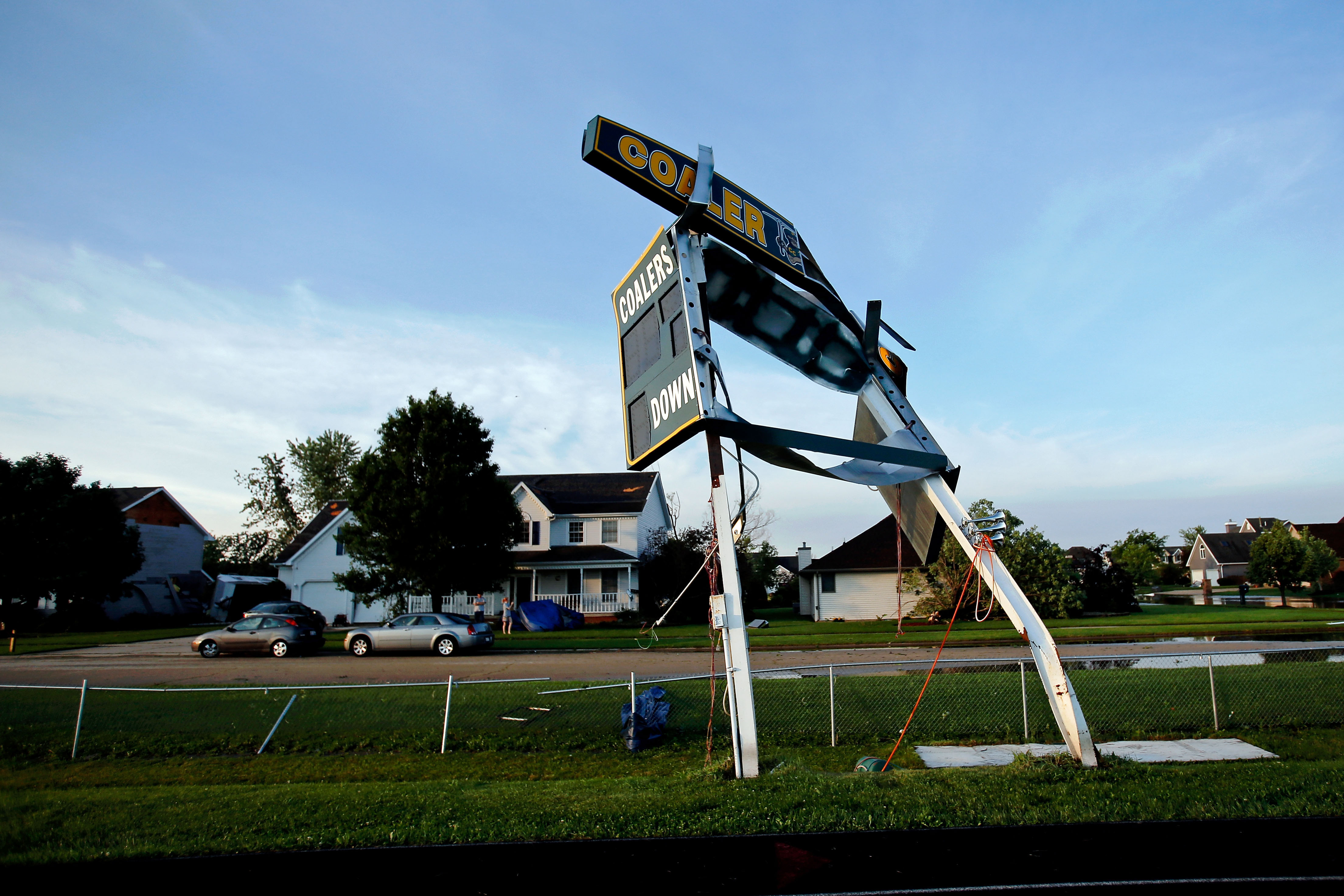 The scoreboard at Coal City High School's football field is left damaged after a tornado struck the previous day on June 23, 2015 in Coal City, Illinois.