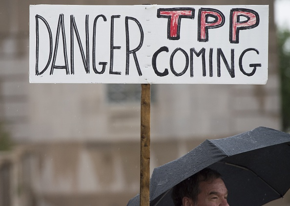 Demonstrators protest against the legislation to give President Barack Obama fast-track authority to advance trade deals, including the Trans-Pacific Partnership (TPP), during a protest march on Capitol Hill in Washington, DC, May 21, 2015.