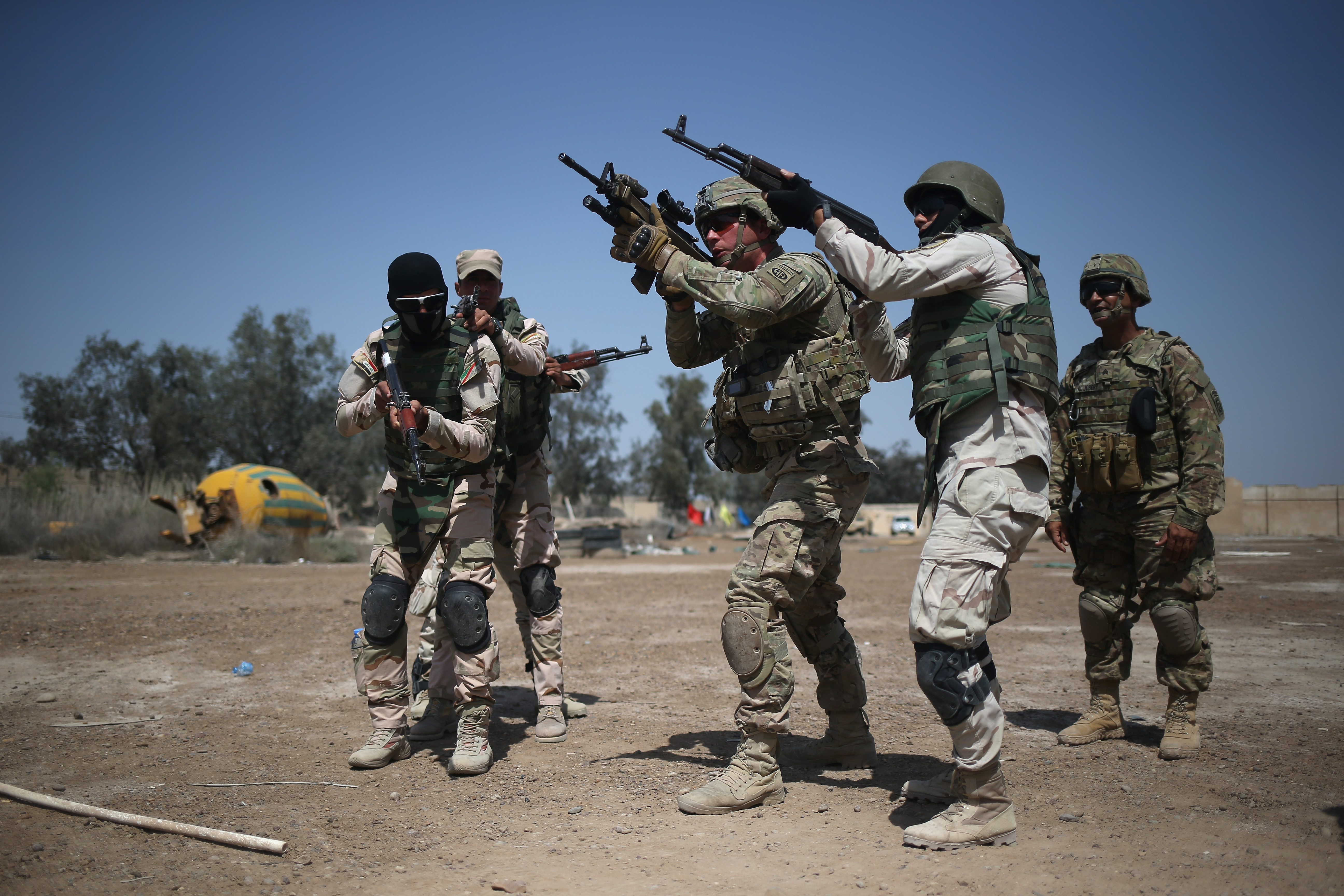 U.S. Army trainers instruct Iraqi Army recruits at a military base on April 12, 2015 in Taji, Iraq.