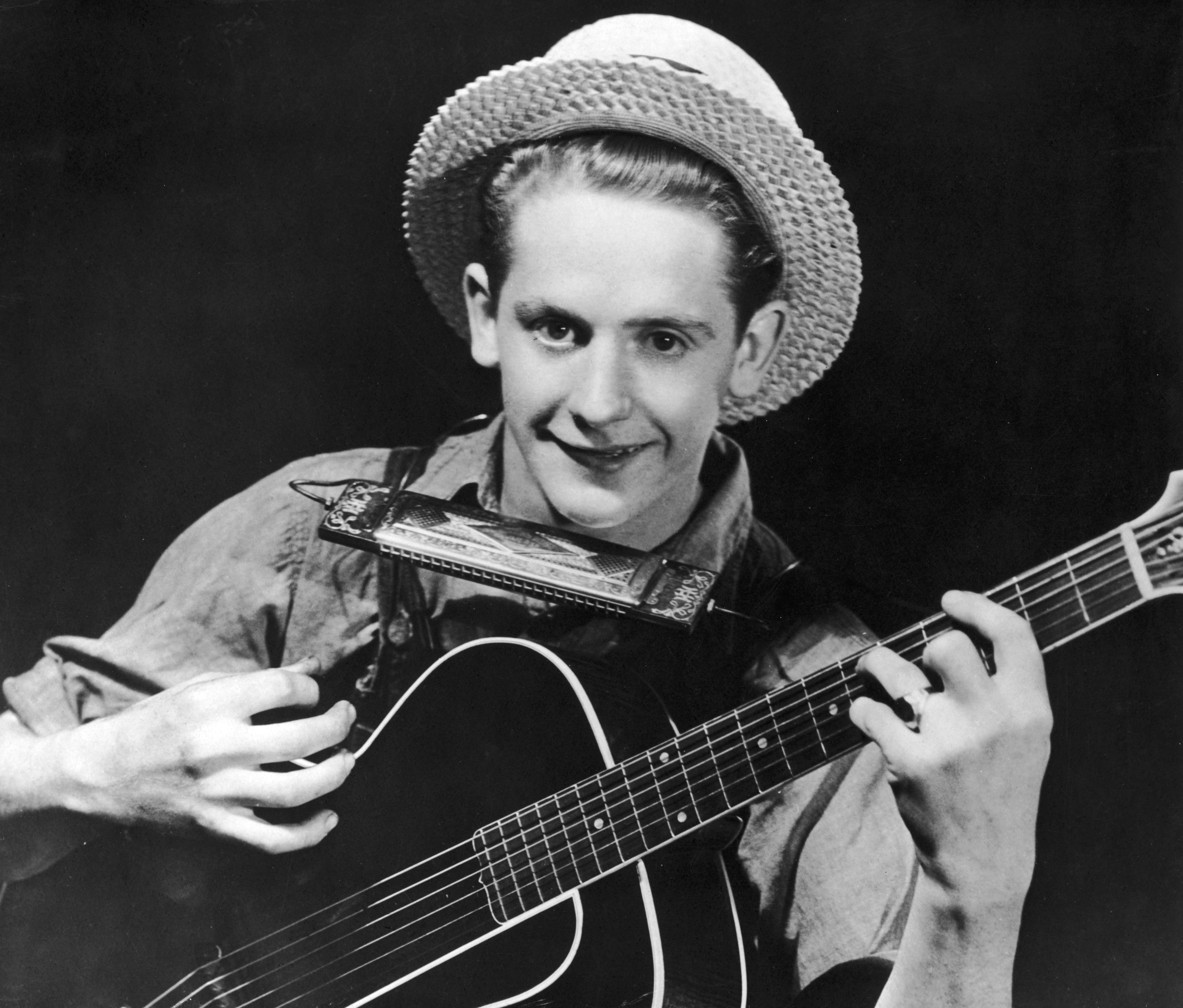 Les Paul was a Grammy Award-winning guitarist and inventor whose innovations helped shape the sound of rock and roll. Paul, shown above in a 1935 photo, pioneered the shift from the acoustic to electric guitar and later developed multitrack recording, which allowed groups to record different parts of their compositions at different times.