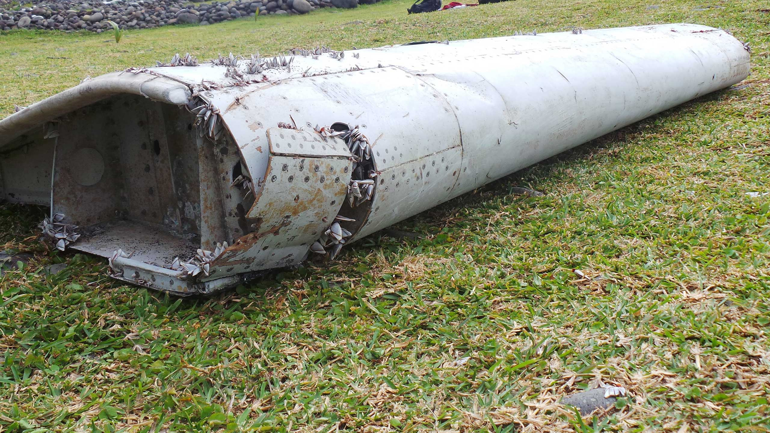 A piece of debris from an unidentified aircraft apparently washed ashore in Saint-Andre de la Reunion, eastern La Reunion island, France, on July 29, 2015.