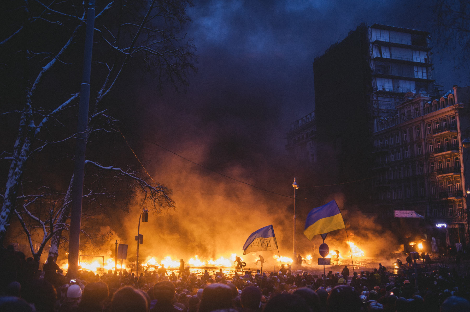 For a few days barricades were burning on Hrushevskoho street, they were all the time with new tires and Molotov cocktails. Jan. 23, 2014, Kiev, Ukraine.                                 From the series  Culture of the Confrontation