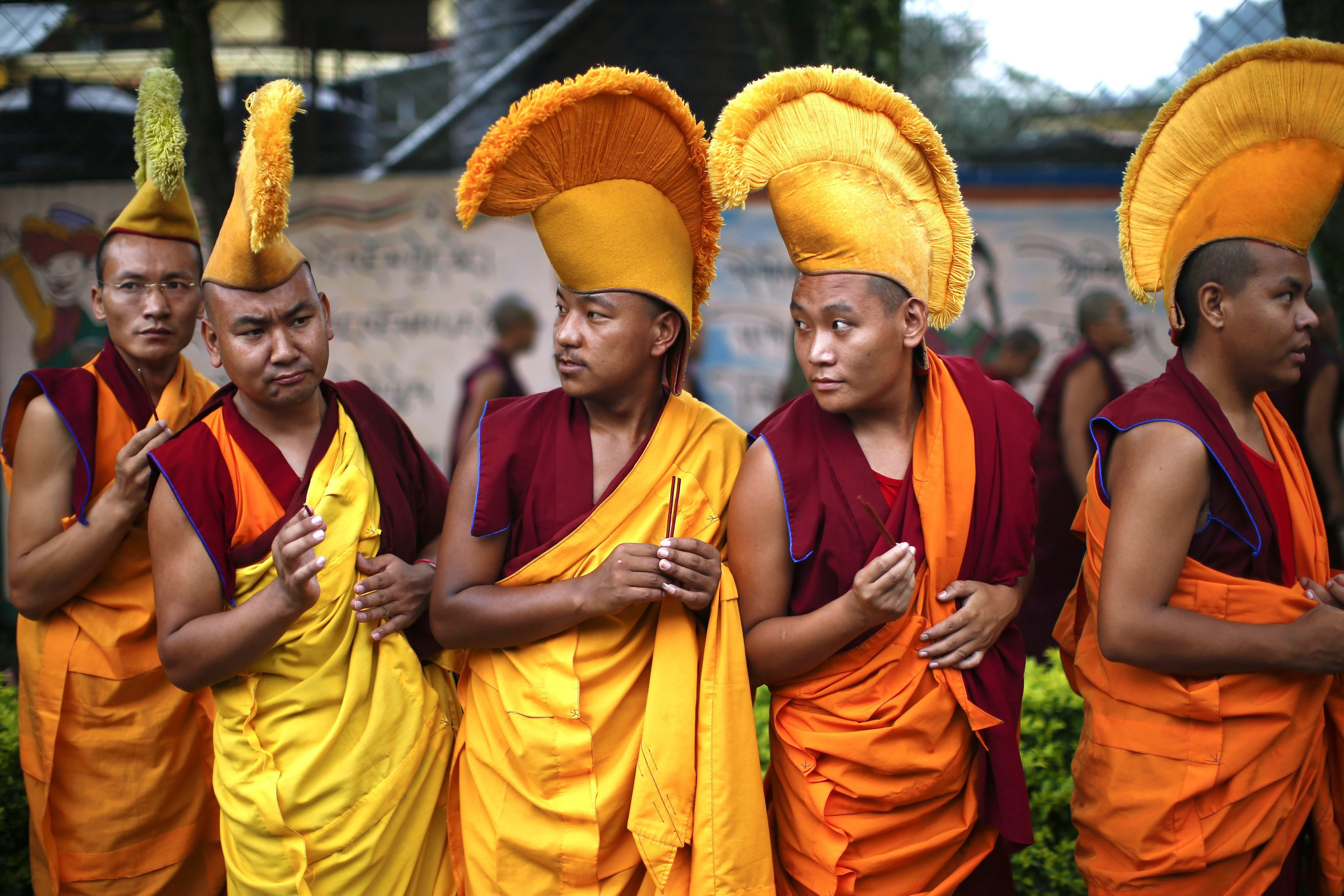 Exiled Tibetan monks attend a procession for the Tibetan spiritual leader the Dalai Lama's 80th birthday at Namgyal School  in Kathmandu on July 6, 2015.