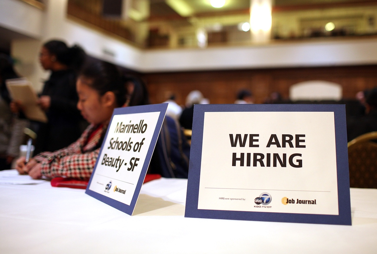 SAN FRANCISCO, CA - MARCH 27:  A  we are hiring  sign is displayed on a table during the San Francisco Hirevent job fair at the Hotel Whitcomb on March 27, 2012 in San Francisco, California. As the national unemployment rate stands at 8.3 percent, job seekers turned out to meet with recruiters at the San Francisco Hirevent job fair where hundreds of jobs were available.  (Photo by Justin Sullivan/Getty Images)