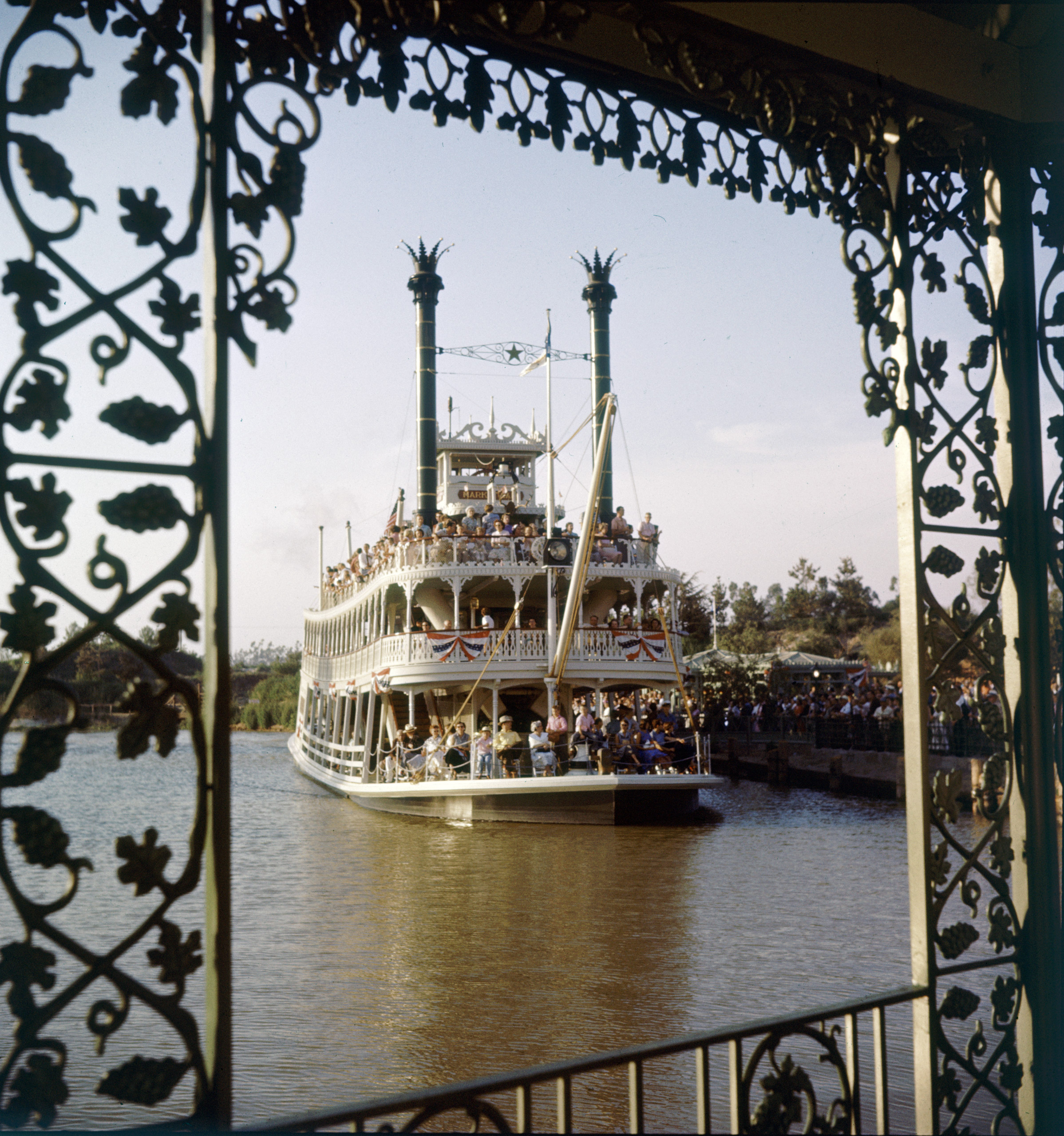 People riding a riverboat at Disneyland Amusement Park, 1955.