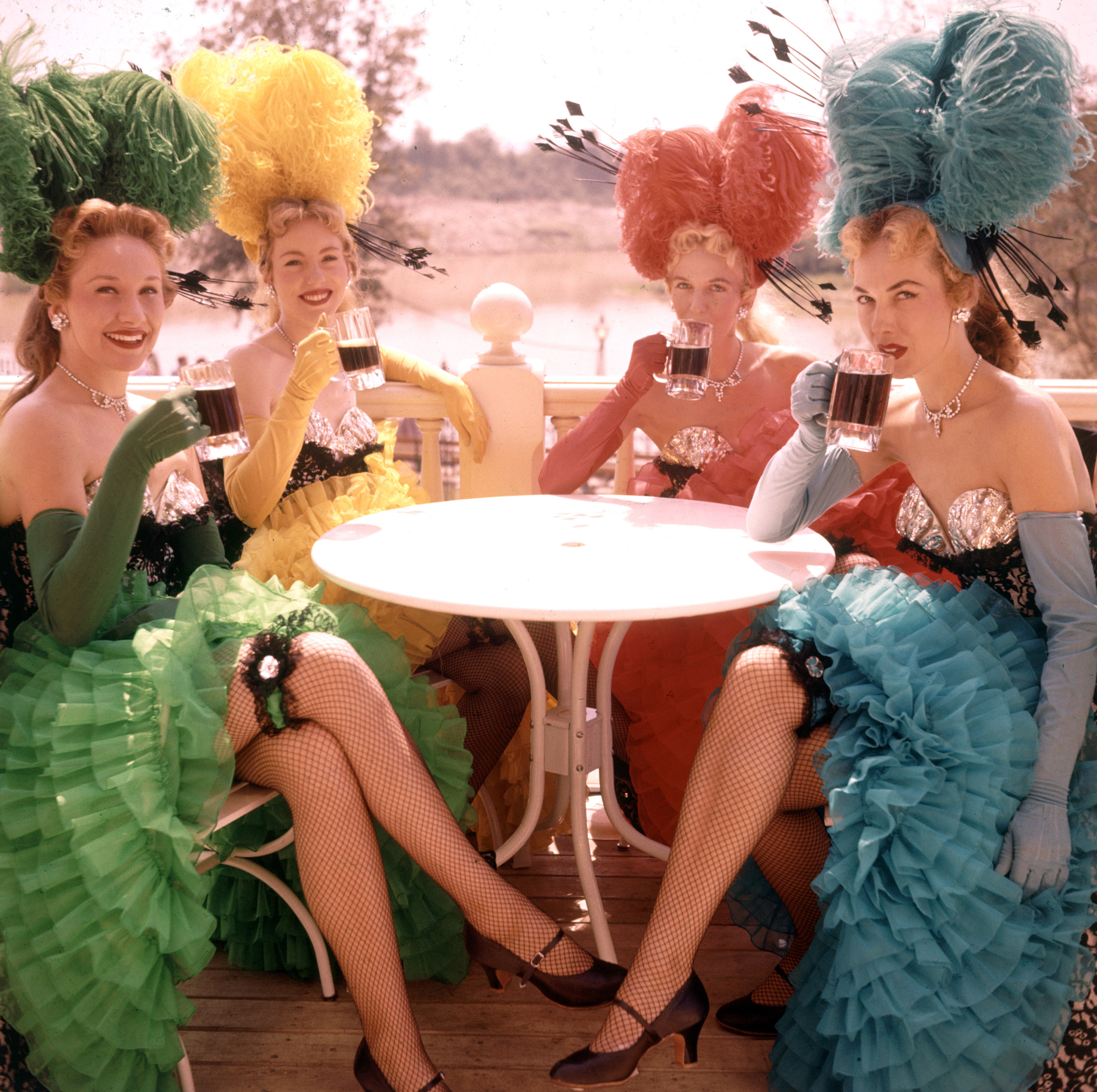 Showgirl performers taking a break and having a drink at Disneyland Amusement Park, 1955.