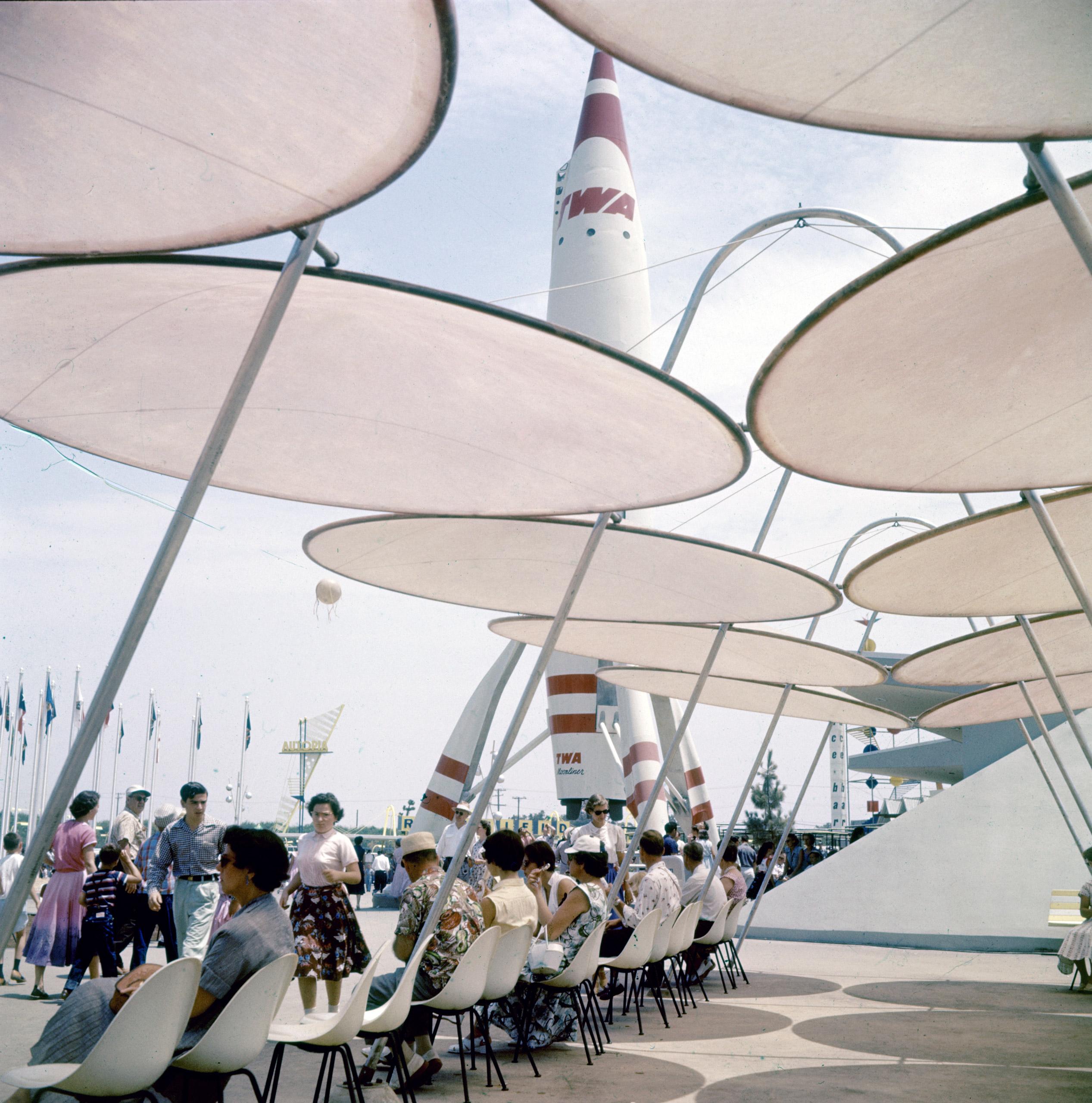 People resting by TWA rocket at Disneyland Amusement Park, 1955.