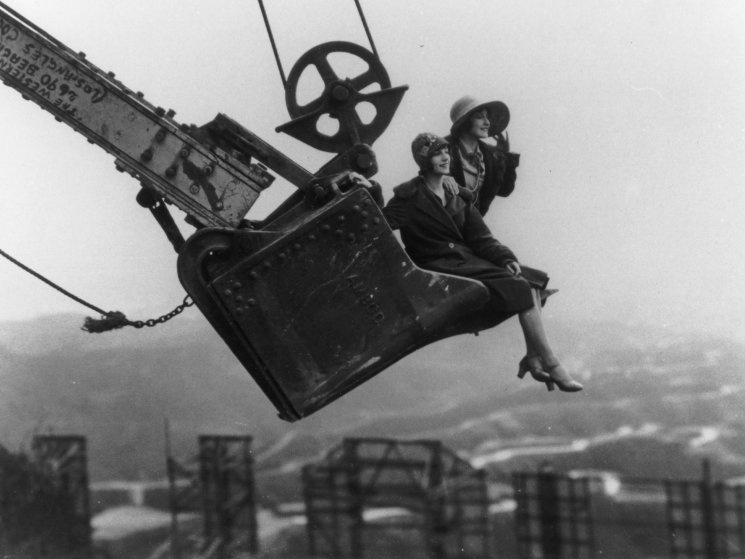 Ladies in a steam shovel bucket, behind the Hollywoodland sign, 1923.