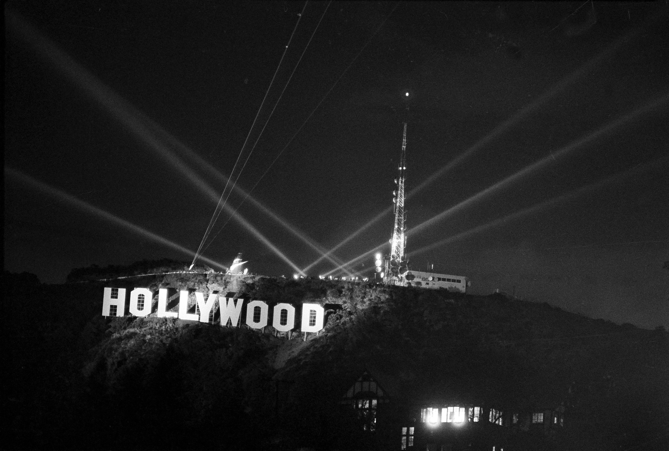 Amid laser beams and searchlights, the new  Hollywood  sign near the top of Mt. Lee in Los Angeles, is unveiled after its dedication, Nov. 11, 1978. The old landmark sign it replaces was built in 1923, but deteriorated and began to fall apart recently. The 50-foot high and 400-foot long sign was replaced by donations from nine public donors totaling $250,000.