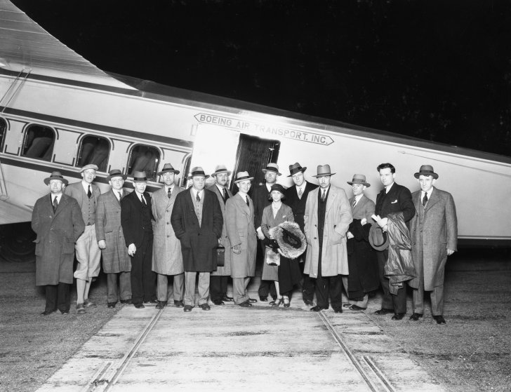 Passengers pose in front of the Model 80, built by Boeing Air Transport.
