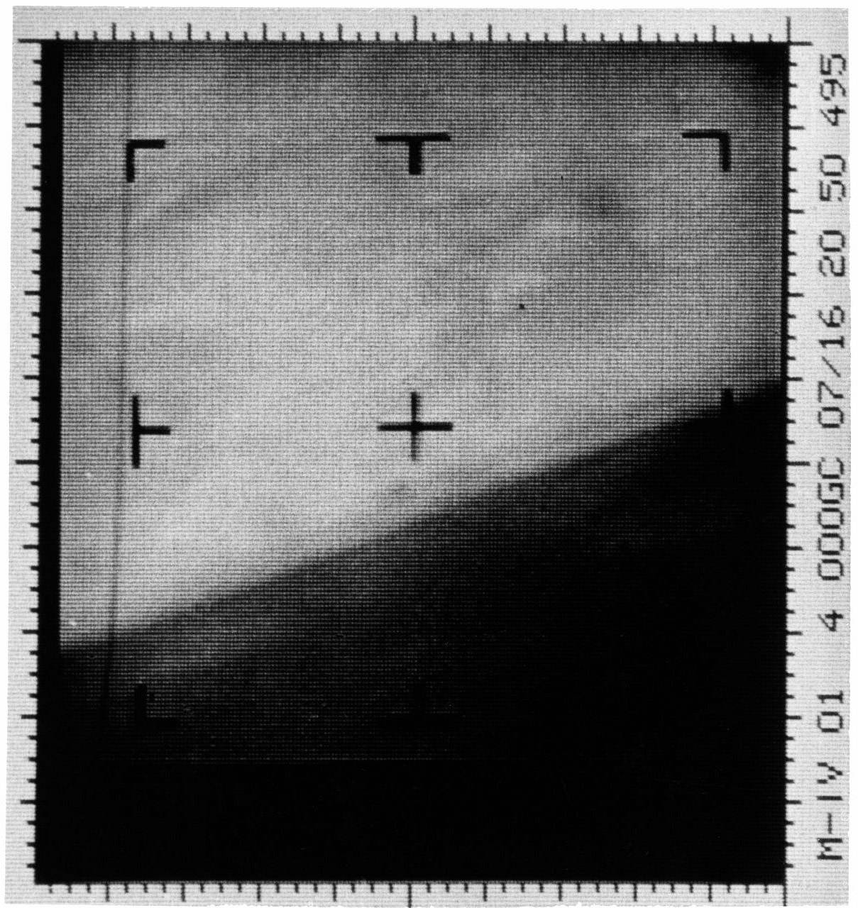 An enhanced contrast version of the first Mars photograph released on July 15, 1965