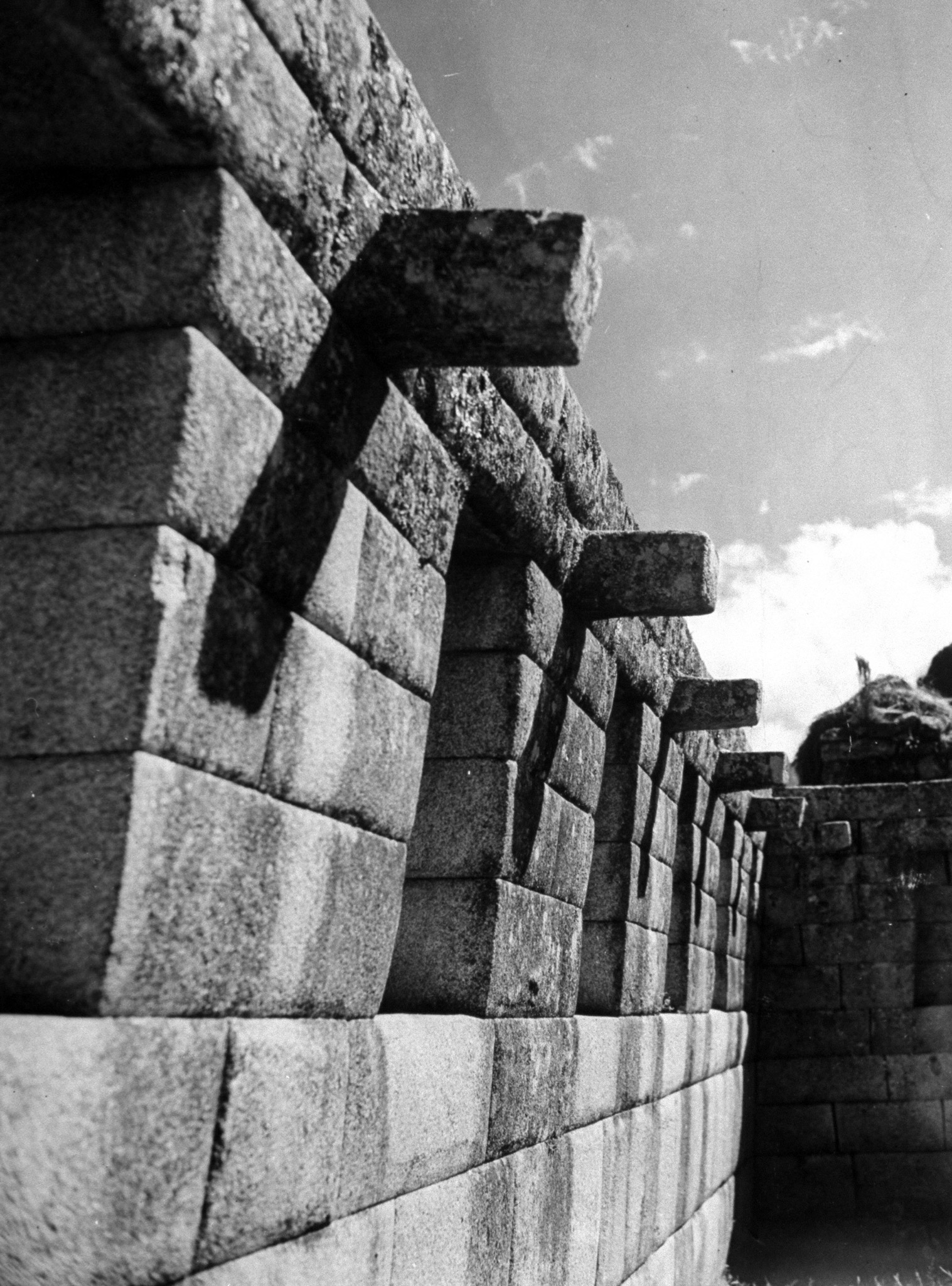 <b>Caption from LIFE.</b> Square pegs along inside of roof of Machu Picchu temple were possibly used to tie on the roof beams.