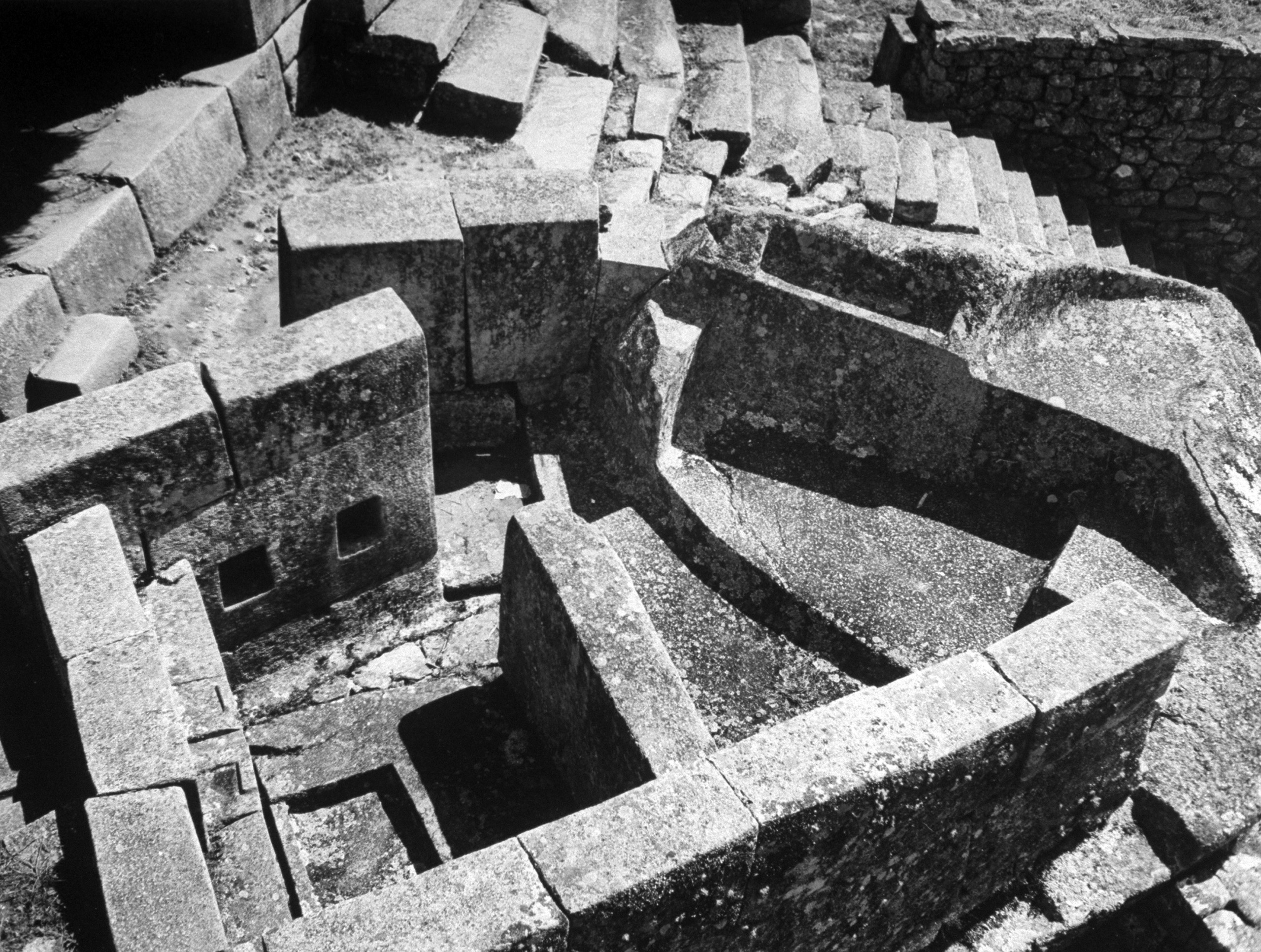 """<b>Caption from LIFE.</b> Bath at Machu Picchu is at lower left. The """"tub"""" is about a foot deep. The water ran down shallow channel which can be seen cutting under wall at extreme lower left."""