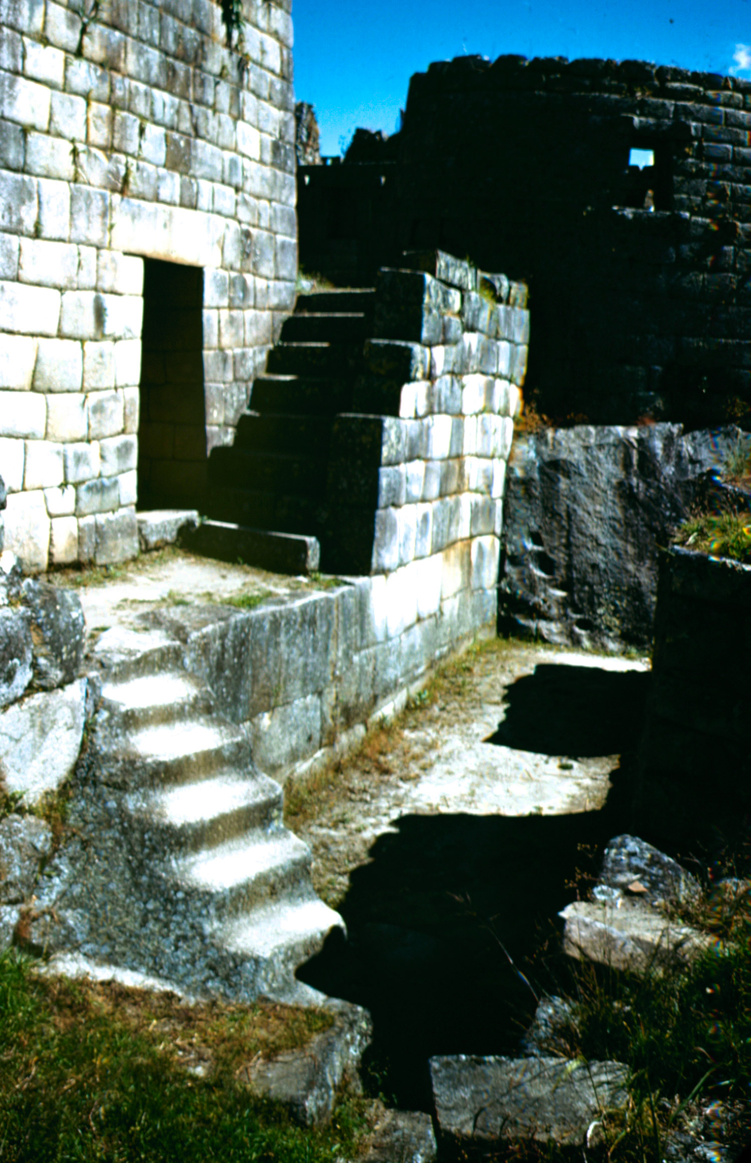 <b>Caption from LIFE.</b> Princess tower at right looks straight down on the Urubamba River. The stairway at left is cut into the solid rock, all hard granite. This is at town of Machu Picchu.