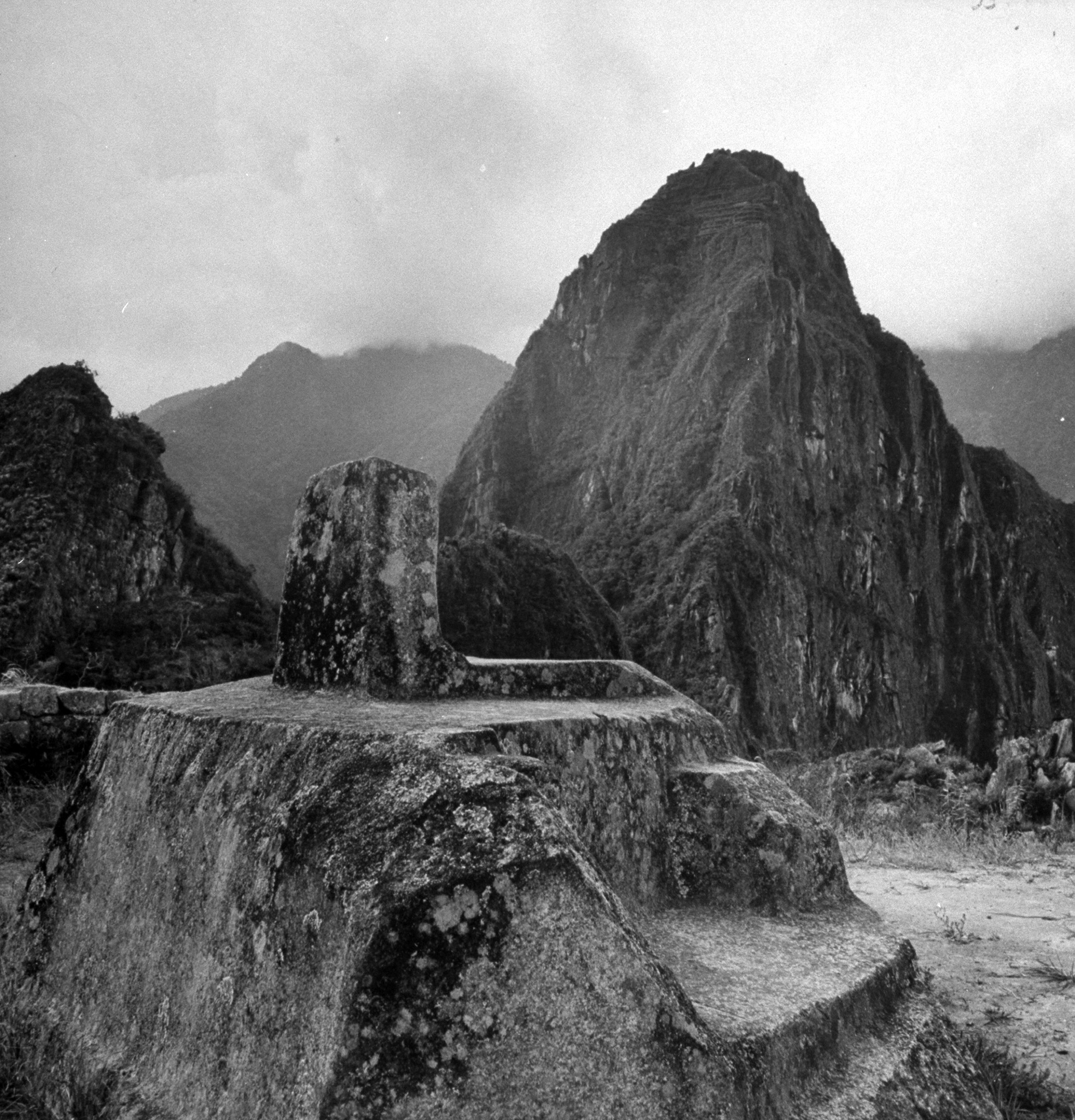 """<b>Caption from LIFE.</b> Intihwatana or """"sun-fixing place,"""" is a sundial. Mountaintop (upper right) shows faint remains of village."""