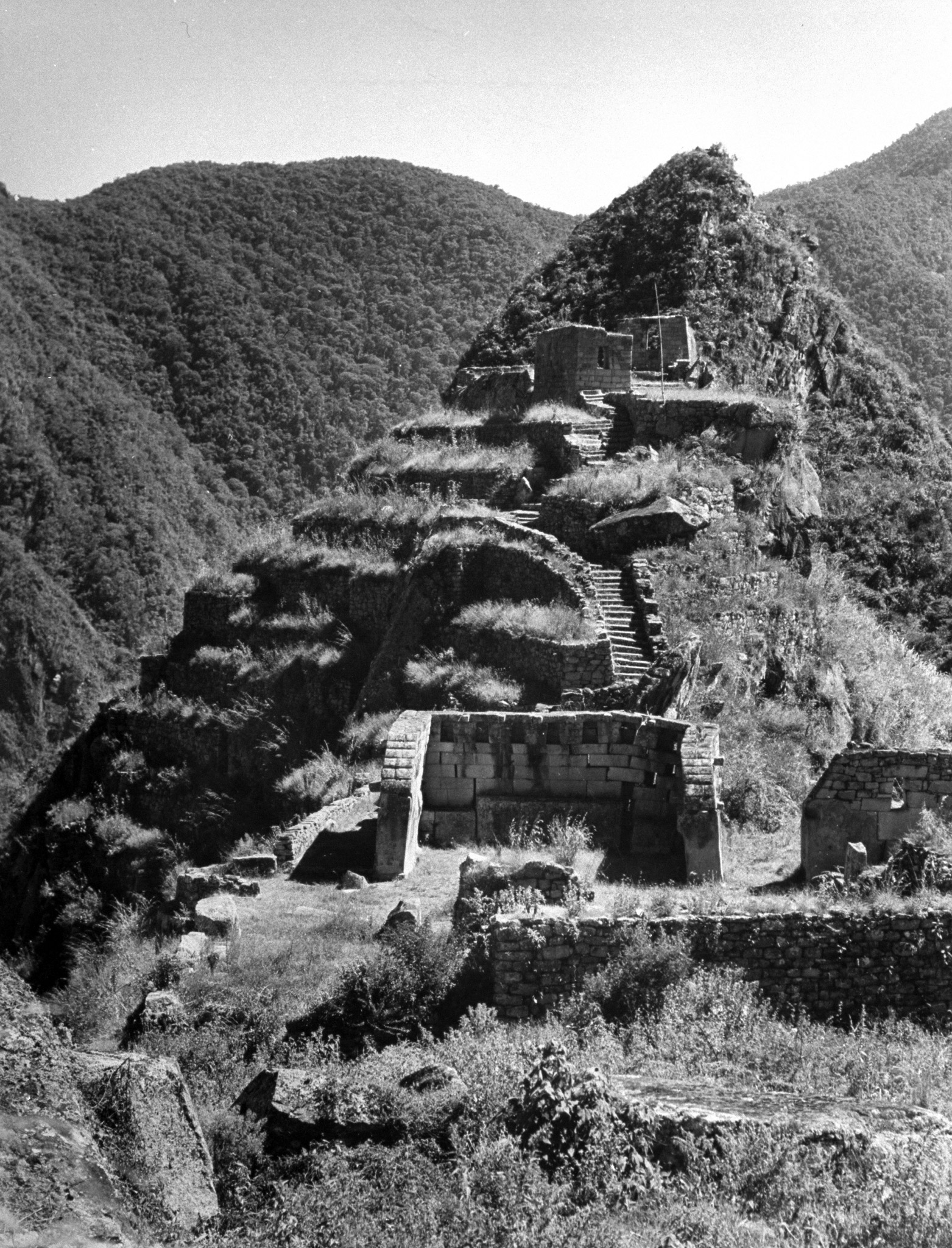 A view showing the temple with the altar. Partway up the hill is the sundial.