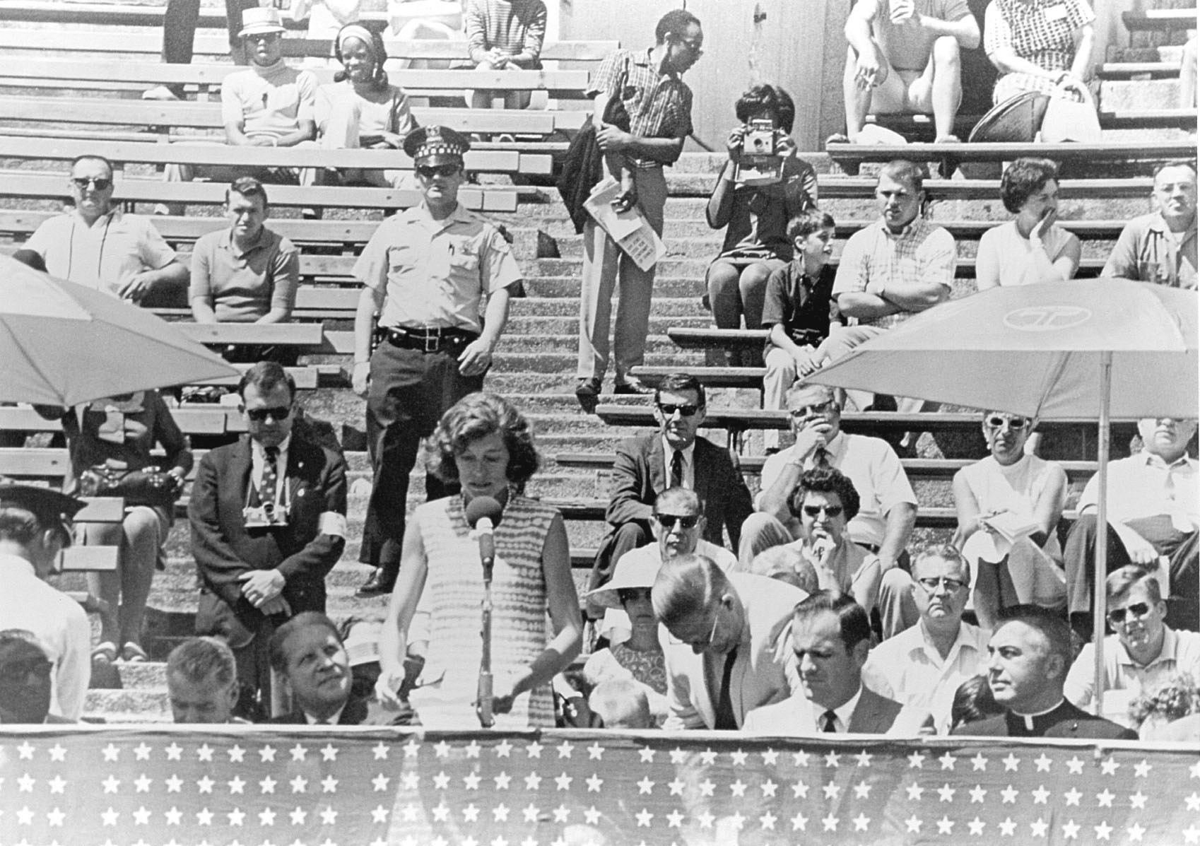 Flanked by political and community leaders of Chicago including Mayor Richard Daley, Eunice Kennedy Shriver declares the first Special Olympics Games open.