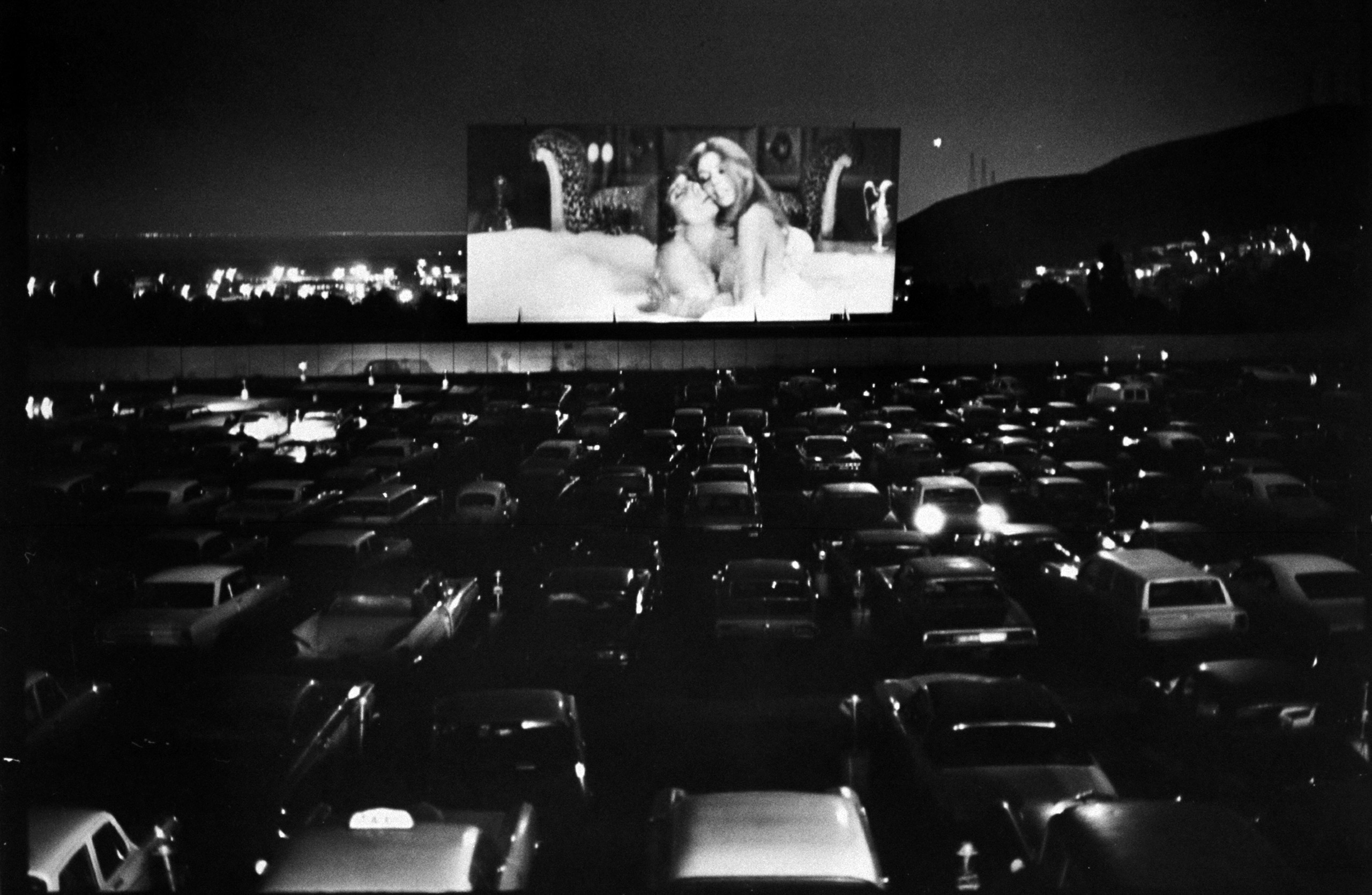 Caption from LIFE. Car-borne moviegoers jam a San Francisco drive-in to watch Beyond the Valley of the Dolls, first high-budget sex film done by Russ Meyer, pioneer  King of the Nudies.