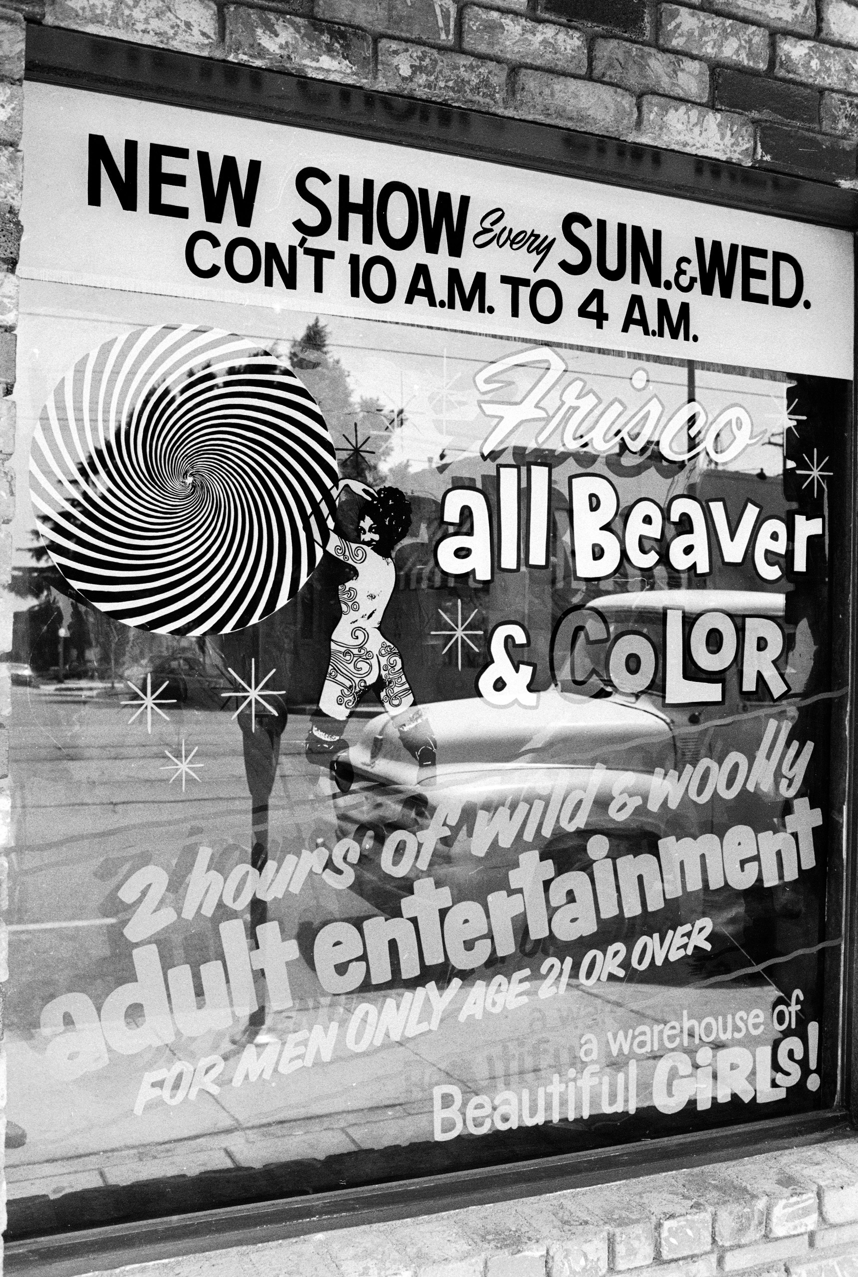 Caption from LIFE. Marquees and bookstore windows mark pornography's wide-open beachheads around the United States.