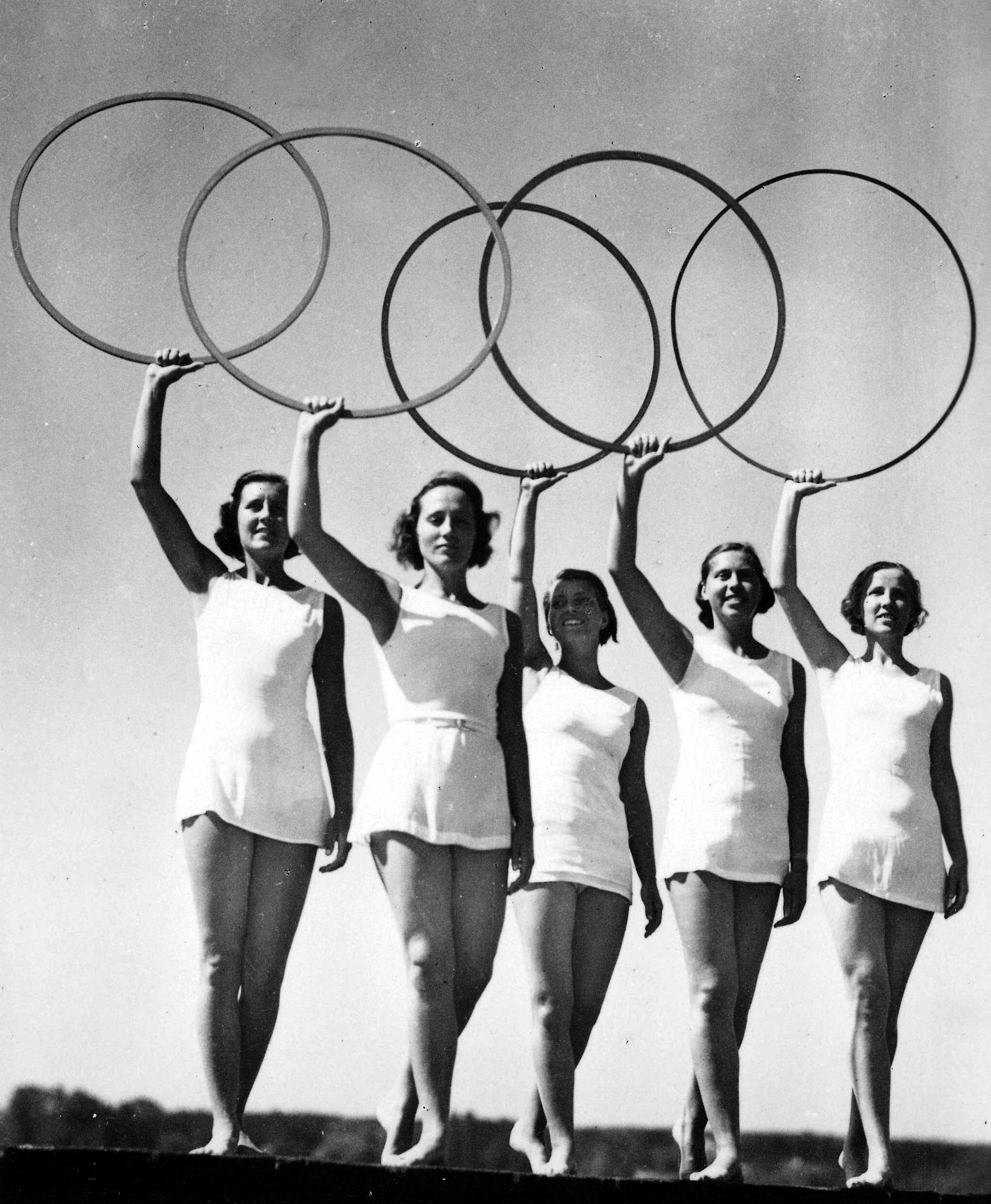 Five young women take part in a display of the Olympic Rings at the 1936 Olympic Games in  Berlin