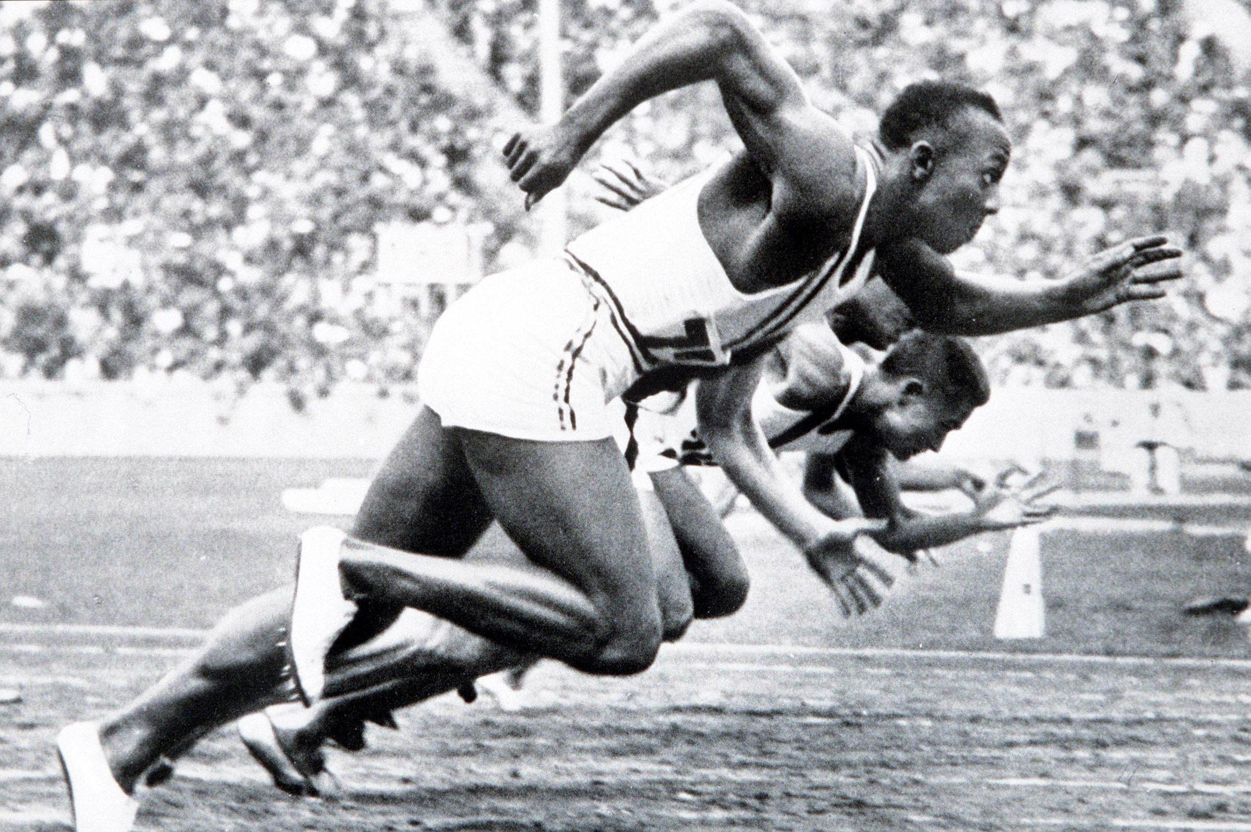 USA's legendary Jesse Owens on his way to winning one of his four gold medals, in the men's 100 meter final at the 1936 Olympic Games in Berlin