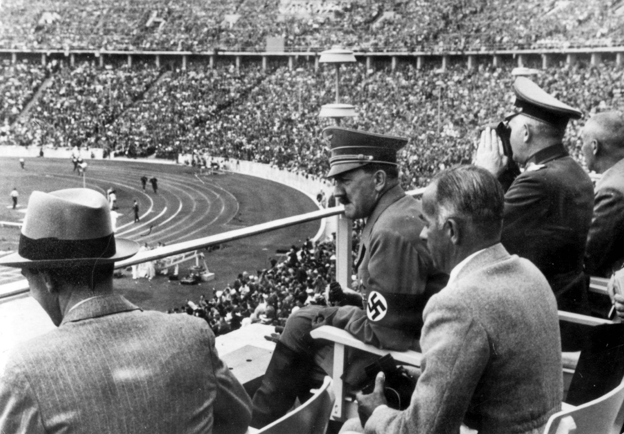 Dr. Joseph Goebbels, German Chancellor Adolf Hitler, Reichs Sports Leader Hans von Tschammer und Osten and Generalfeldmarschall Werner von Blomberg observe the Olympic Games in Berlin, Germany in August 1936.