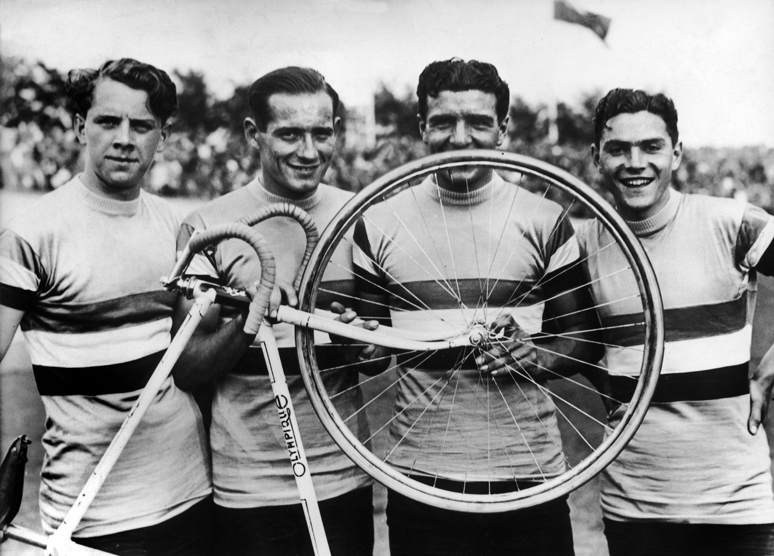The Racing Cyclists Robert Charpentier, Guy Lapebie, Jean Goujon and Roger Le Nizerhy just after having won at the Olympic Games in Berlin in August 1936.