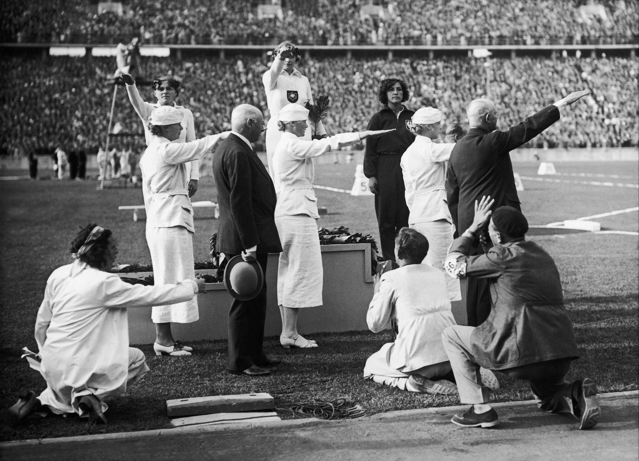 The German female javelin throwers Tilly Fleischer (Gold Medal) and Luis Kruger (Silver Medal) with Polish bronze-medalist Marja Kwasniewska, on the podium at the Olympic Games In Berlin on Aug. 2, 1936.