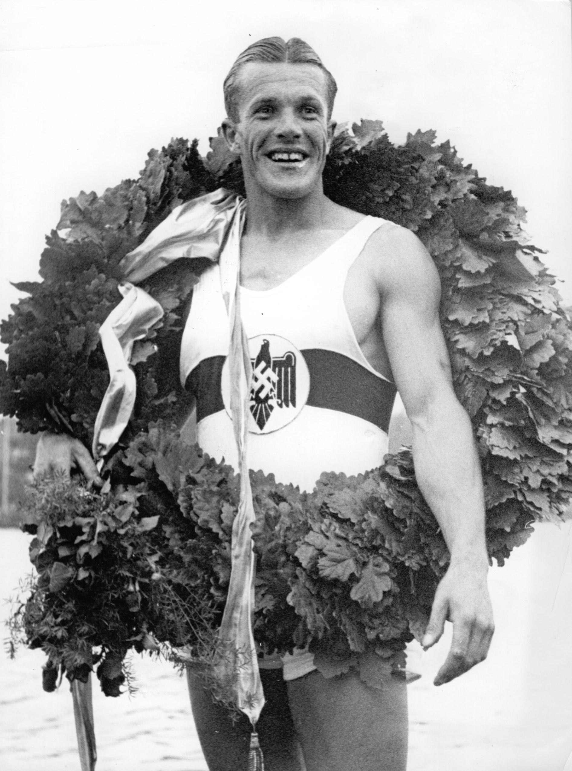 Olympic winner Gustav 'Gummi' Schaefer, German rower, with the laurel wreath during the Summer Olympics in Berlin-Grünau in August 1936.