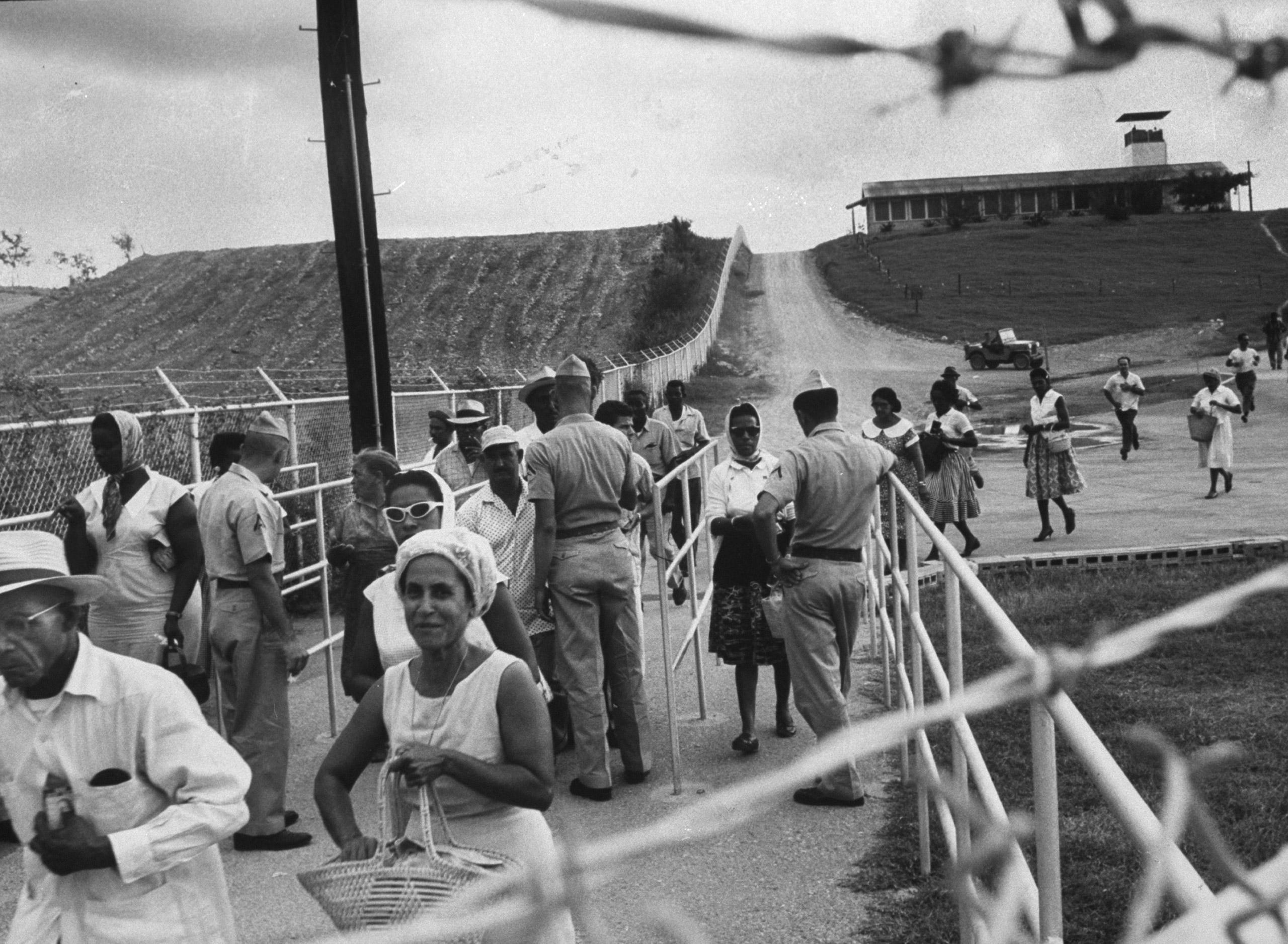 Cuban workers leaving US naval base, Guantanamo Bay, Cuba, 1962.