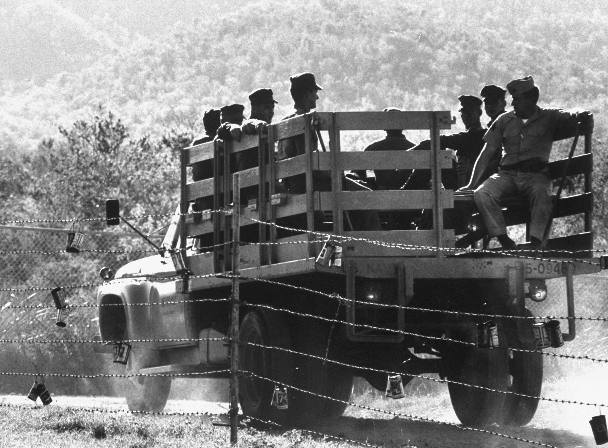 US truck carrying personnel at Guantanamo Naval Base, Guantanamo Bay, Cuba, 1962.