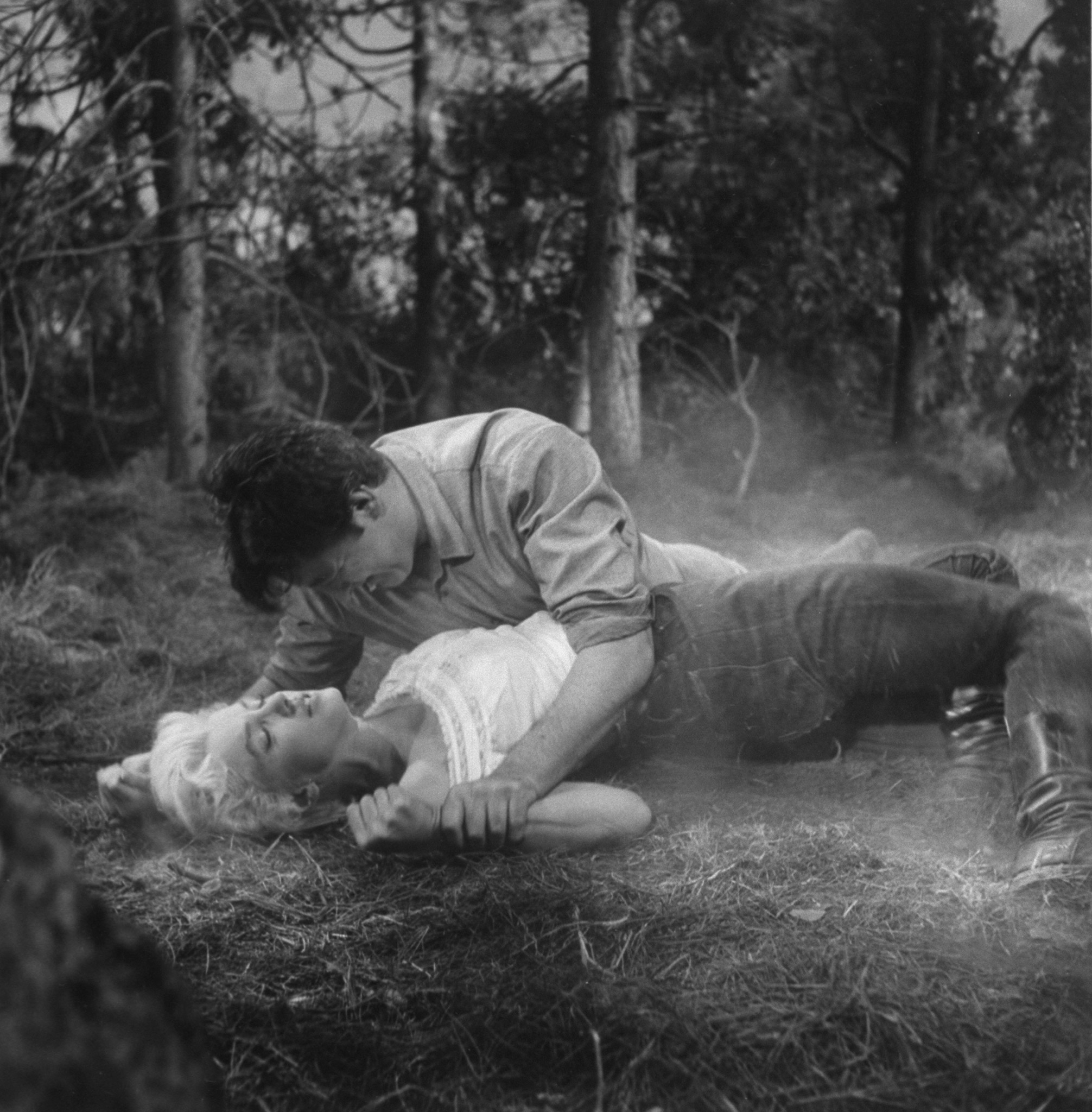 "Actor Robert Mitchum wrestles with Marilyn Monroe in a scene from the film ""River of No Return,"" 1954."