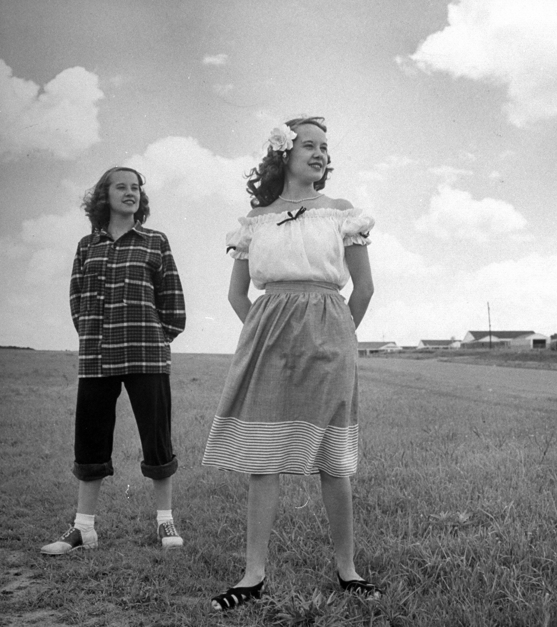 <b>Caption from LIFE.</b> Contrasts in teen-age clothes are shown by Betty Bounds (right), wearing a dainty 1947 outfit, while Barbara poses in sloppy get-up.