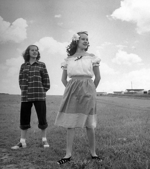 Contrasts in teen-age clothes are shown by Betty Bounds (right), wearing a dainty 1947 outfit, while Barbara poses in sloppy get-up.