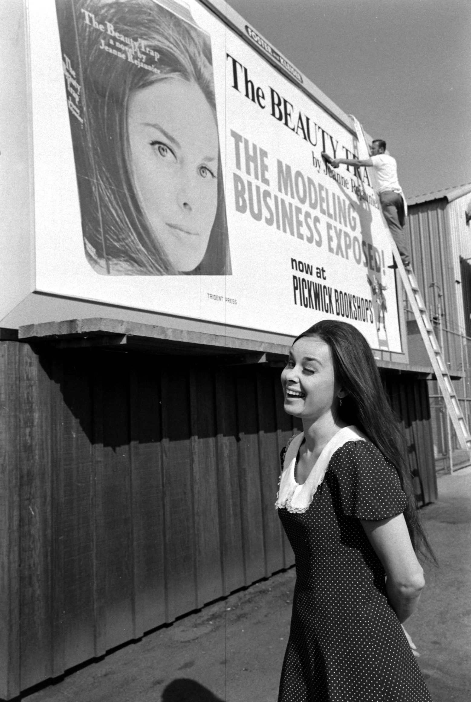Caption from LIFE. A lady author must: have her own billboard. There is a special thrill, Jeanne admits, to seeing yourself on a Hollywood billboard. Now that her face is well-known, she often visits bookstores and boosts her novel's sales.