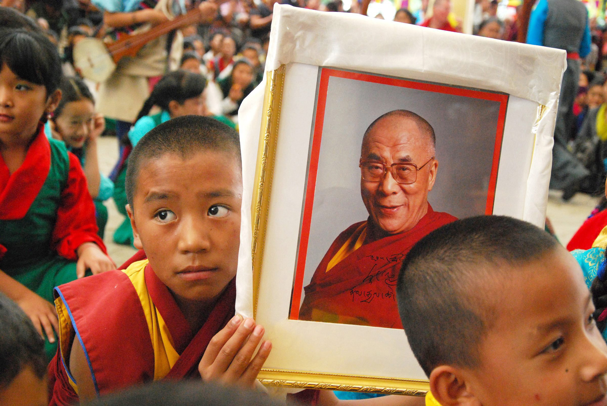 A Tibetan Monk holds a picture of the Dalai Lama, as they celebrate his 80th birthday in Dharmsala, India on July 6, 2015.