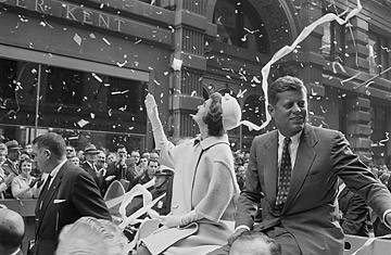 Presidential candidate John F. Kennedy rides on a car with wife Jackie in a ticker-tape parade, Oct. 19, 1960