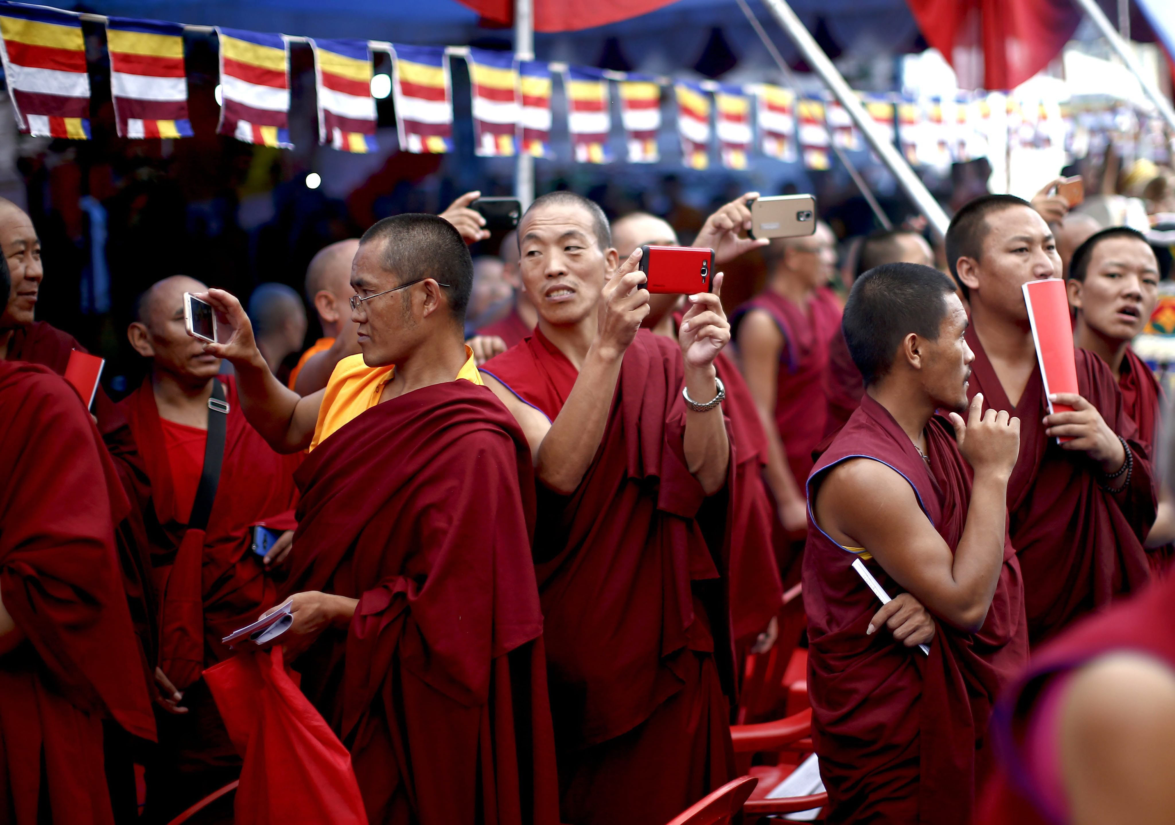 Exiled Tibetan monks attend a procession for the Dalai Lama's 80th birthday at Namgyal School in Kathmandu on July 6, 2015.